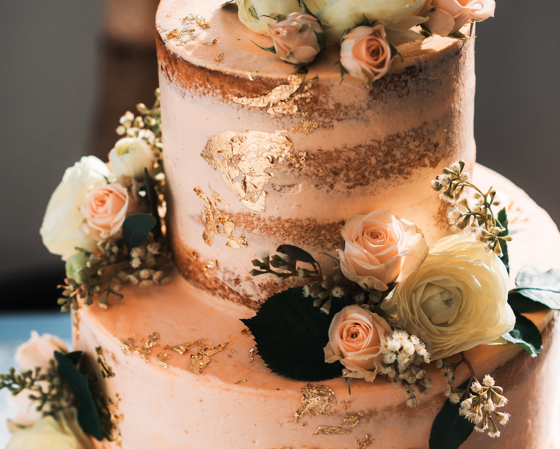 Wedding pink cake with edible flowers