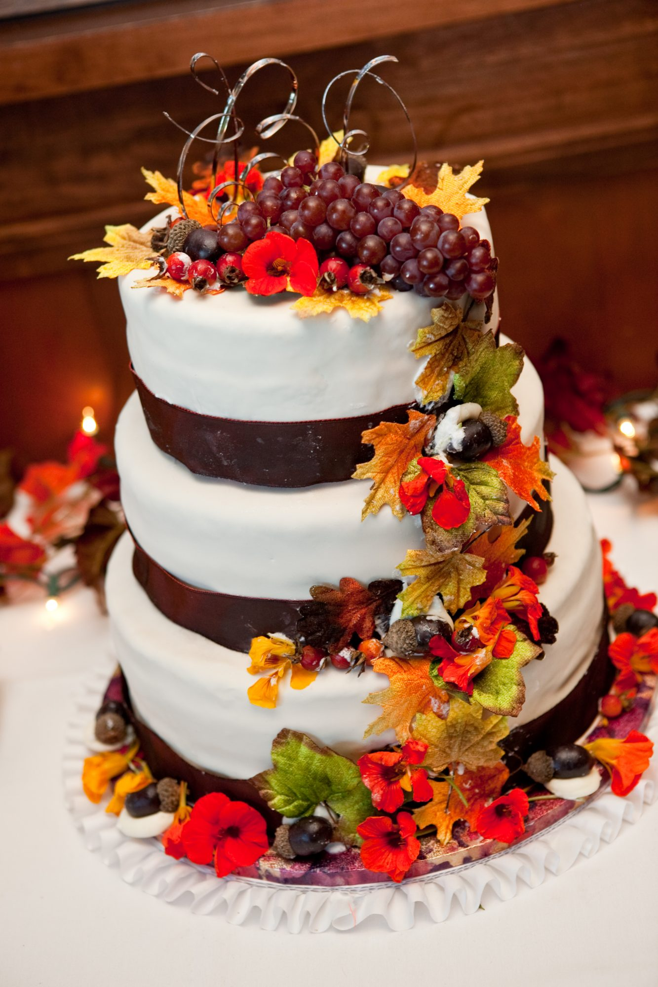 Beautiful Fall Wedding Cake with Grapes, Autumn Leaves, and Acorns