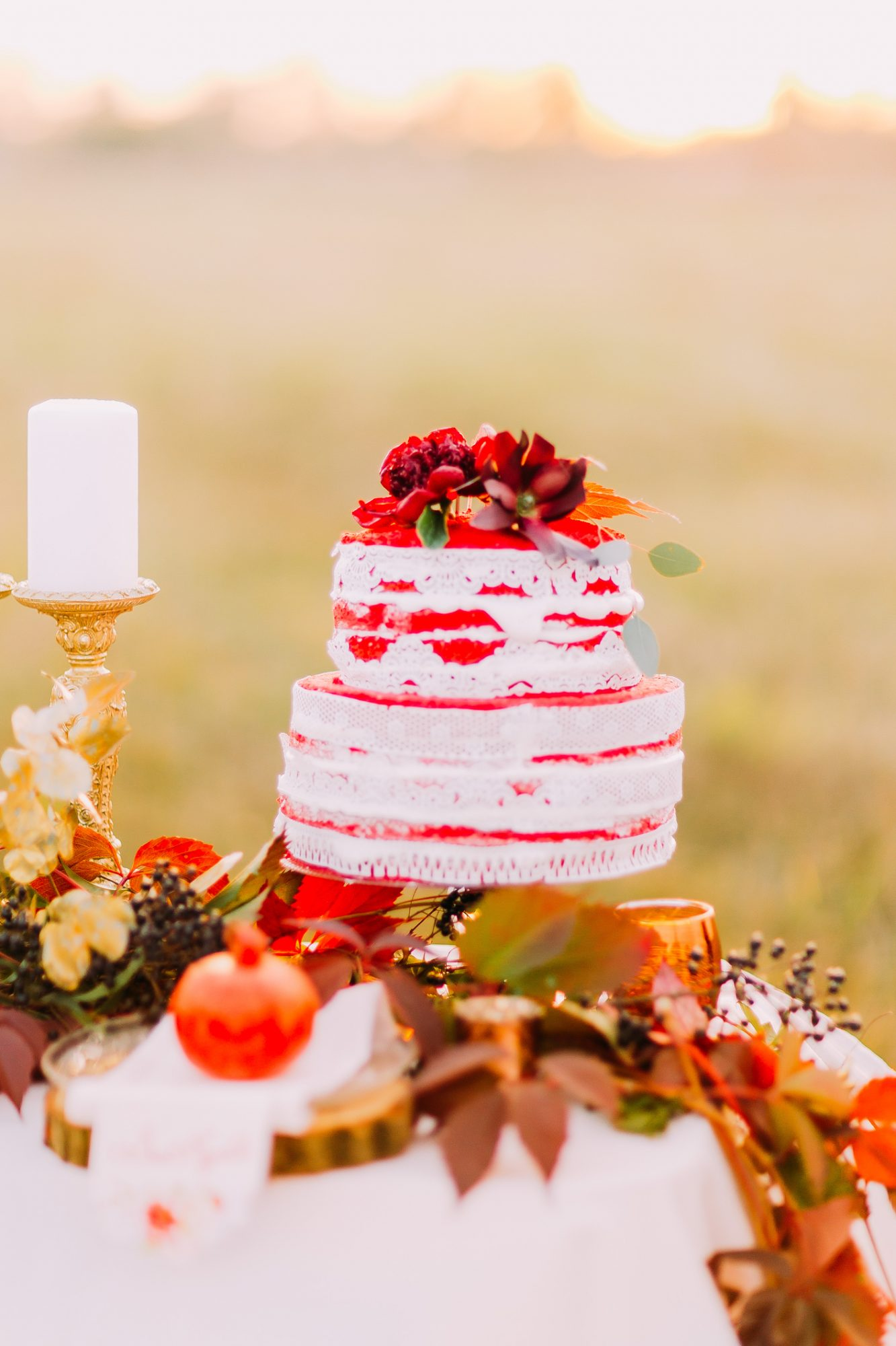 Wedding cake on the table decorated with fallen leaves