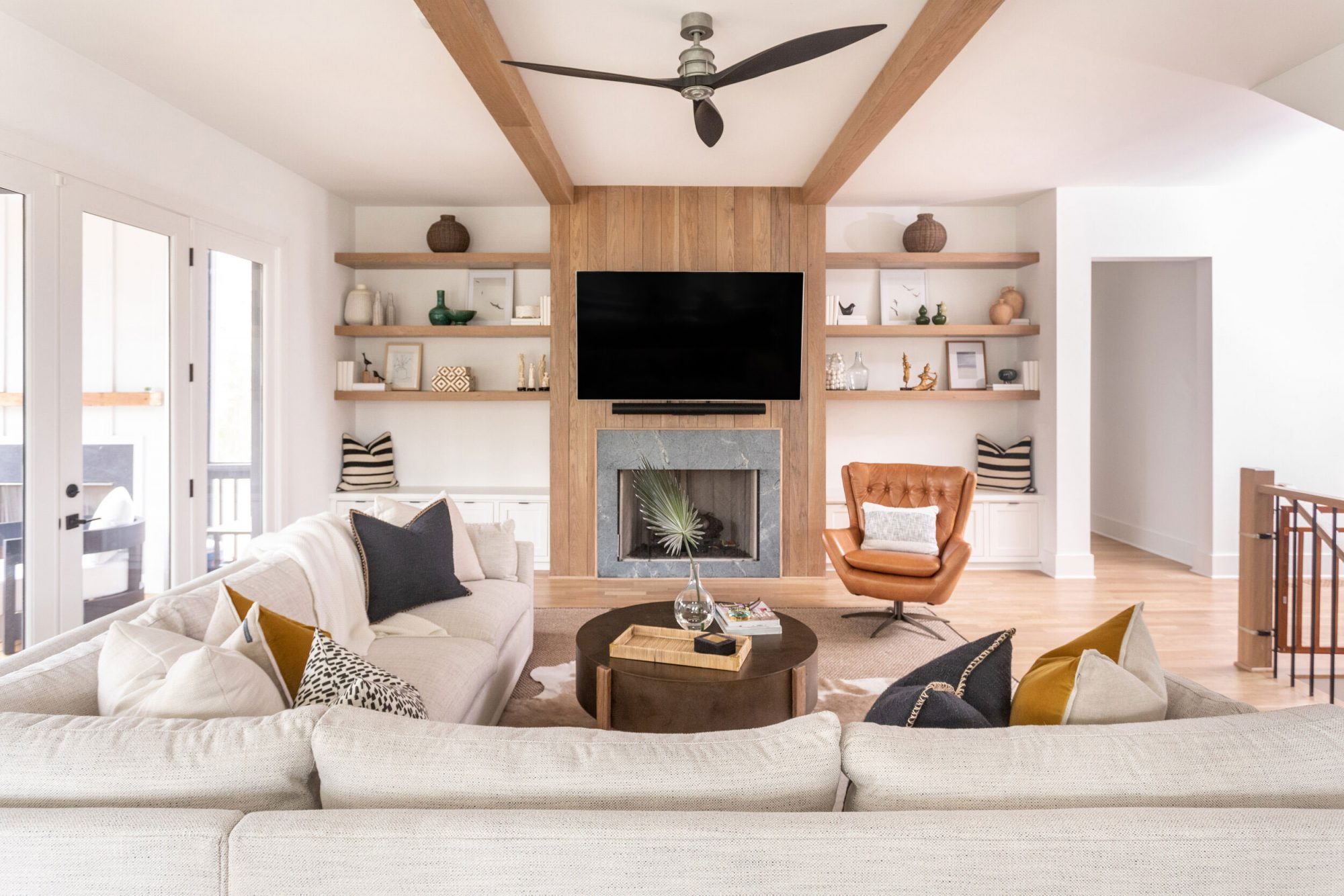 Living Room with Built In Bookshelves and TV Over Fireplace