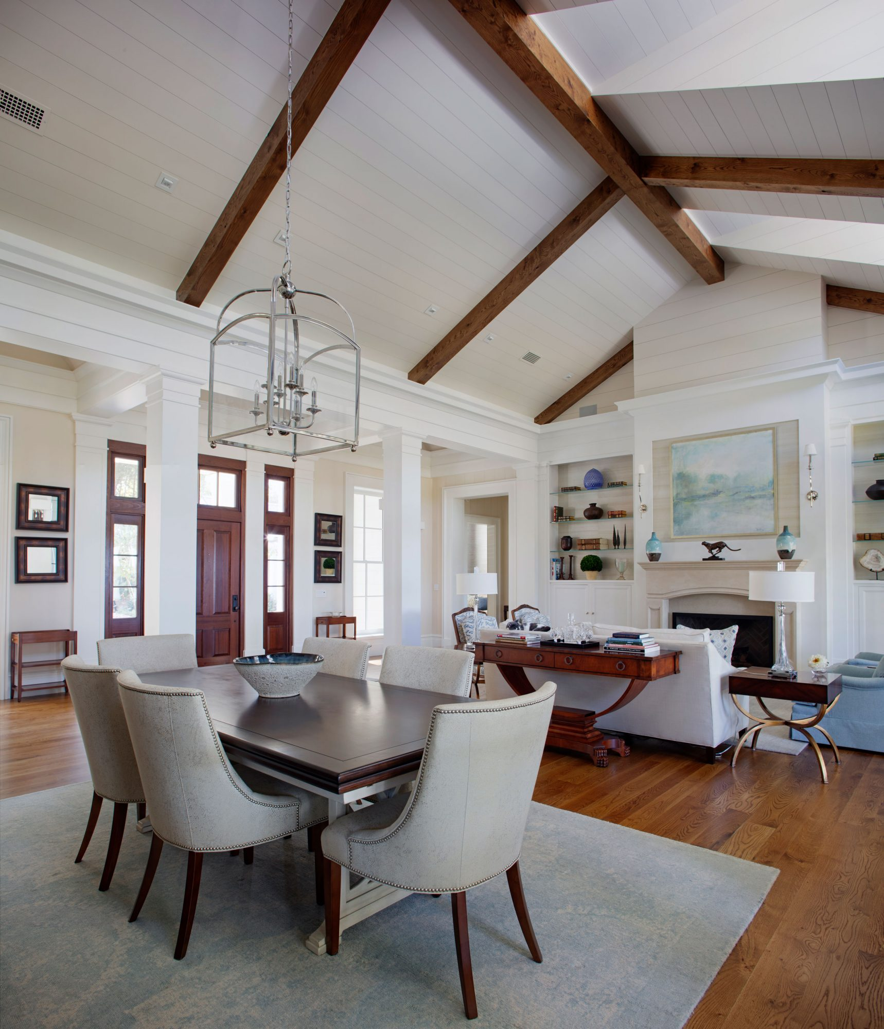 Open Concept Dining Room and Living Room with Vaulted Ceiling and Beams