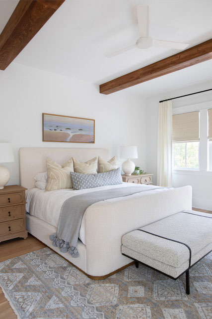 White Main Bedroom with Ceiling Beams and Upholstered Bed