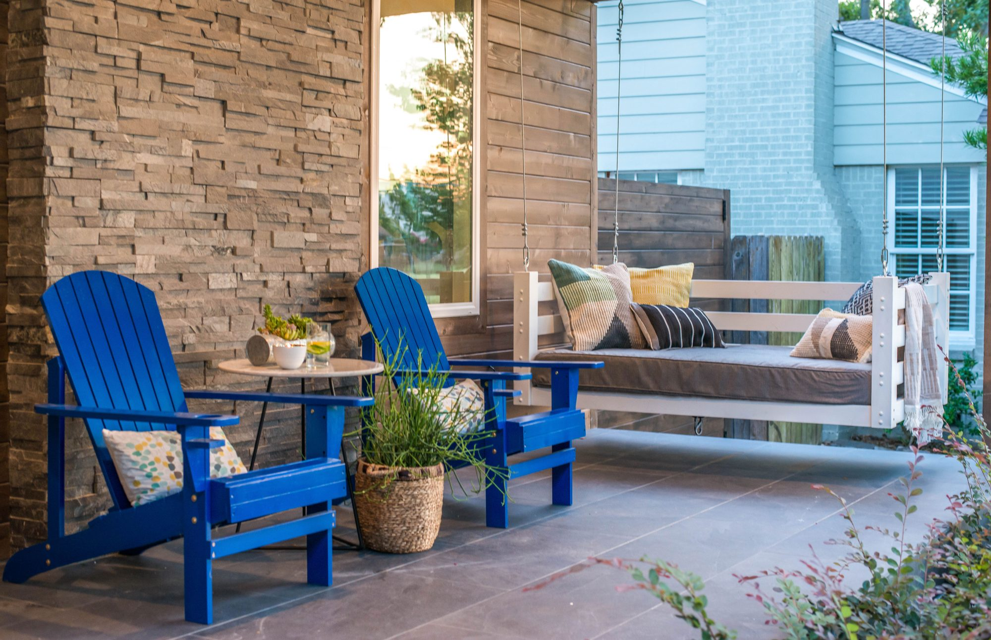 Porch with Blue Adirondack Chairs