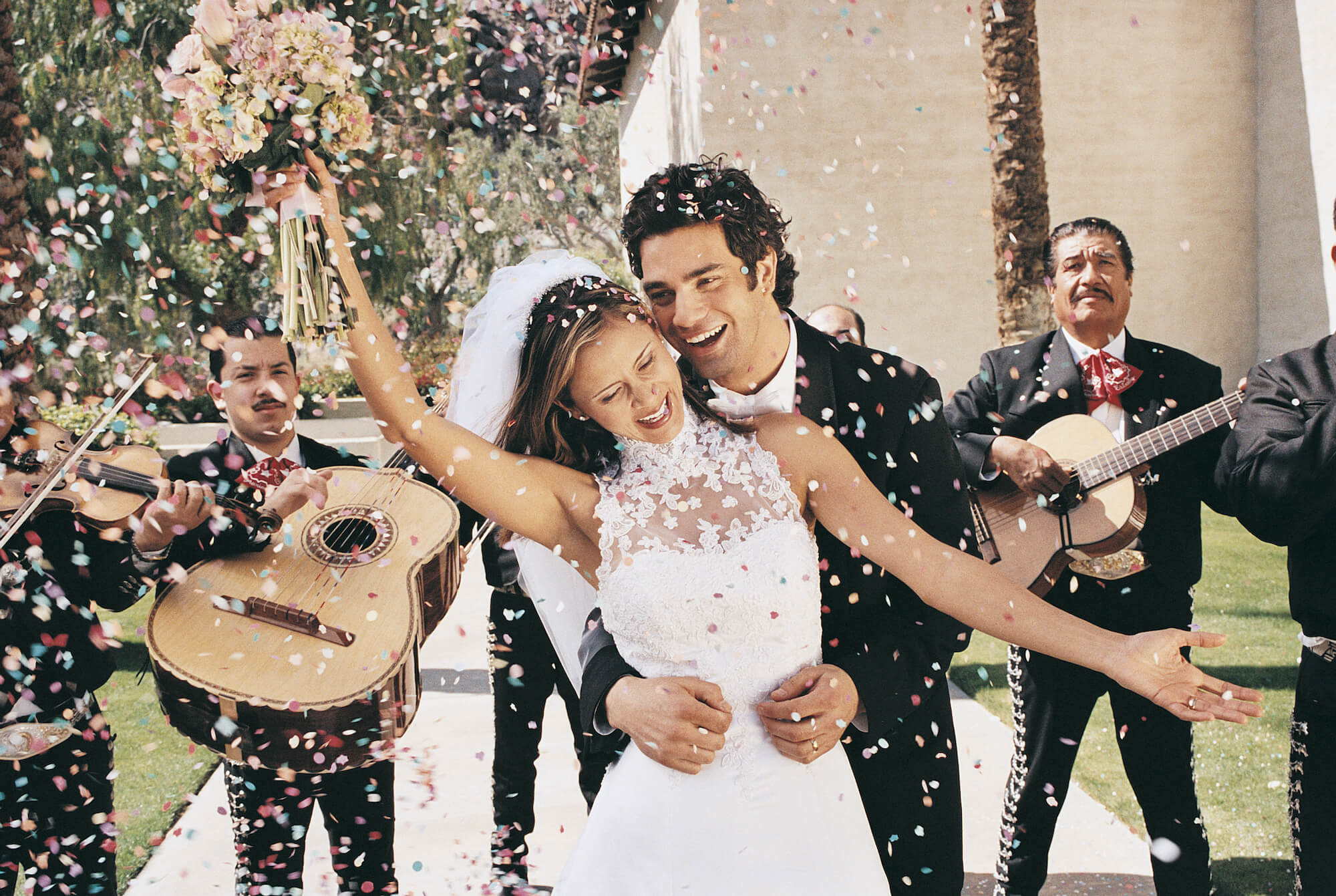 bride and groom with mariachi band