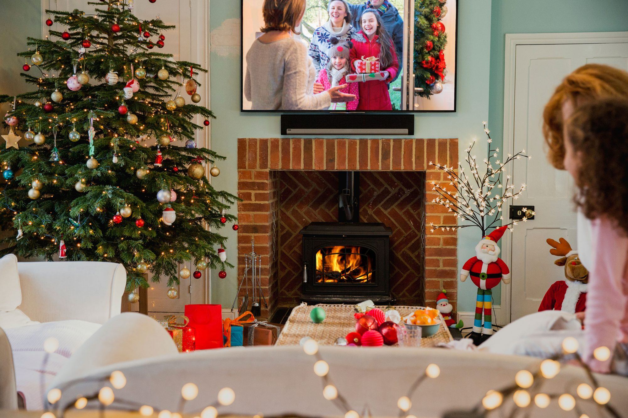 TV Over a Brick Fireplace with Christmas Tree