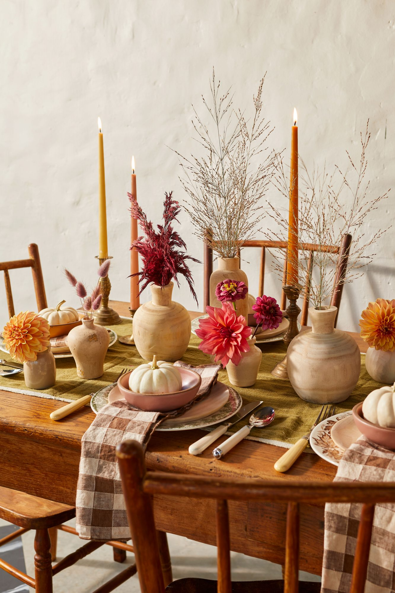 Fall Tablescape with like-toned vessels, dahlias, zinnias, and pampas grass