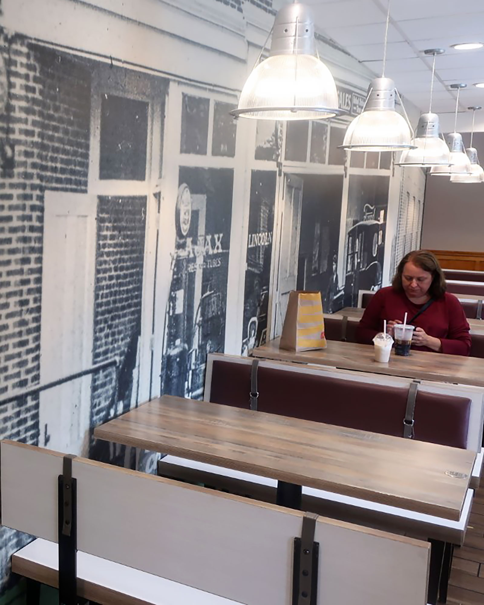 Person dines inside a 150-year-old McDonald's restaurant