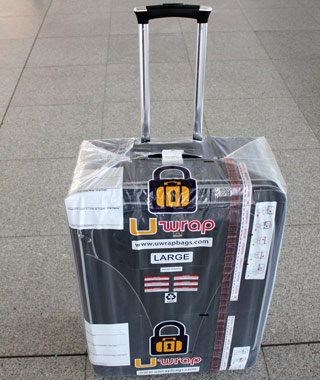 201202-w-prevent-luggage-theft-uwrap