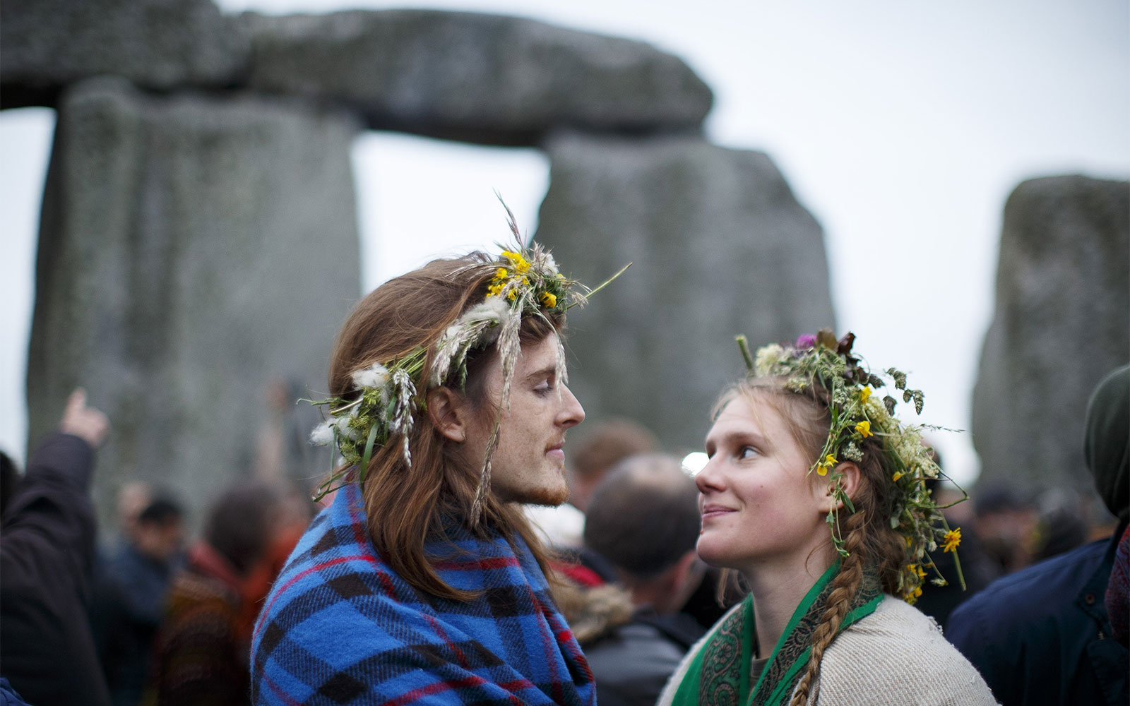 SALISBURY, UNITED KINGDOM - JUNE 21: Revelers take part in celebrations to mark the summer solstice at Stonehenge prehistoric monument on June 21, 2015 in Wiltshire, England. Thousands of revellers gather at the 5,000 year old stone circle in Wiltshire to see the sunrise on the Summer Solstice dawn. The solstice sunrise marks the longest day of the year in the Northern Hemisphere. (Photo by Tolga Akmen/Anadolu Agency/Getty Images)