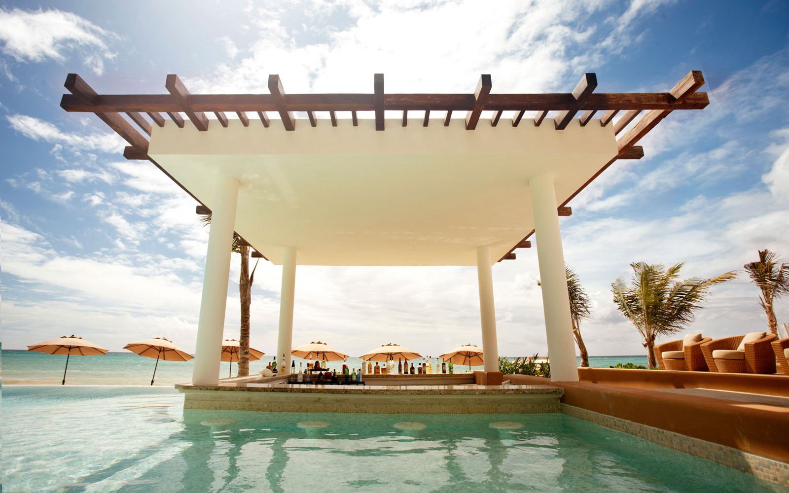 Chill Out at the World's Coolest Swim-Up Bars: Banyan Tree Mayakoba in Riviera Maya, Mexico