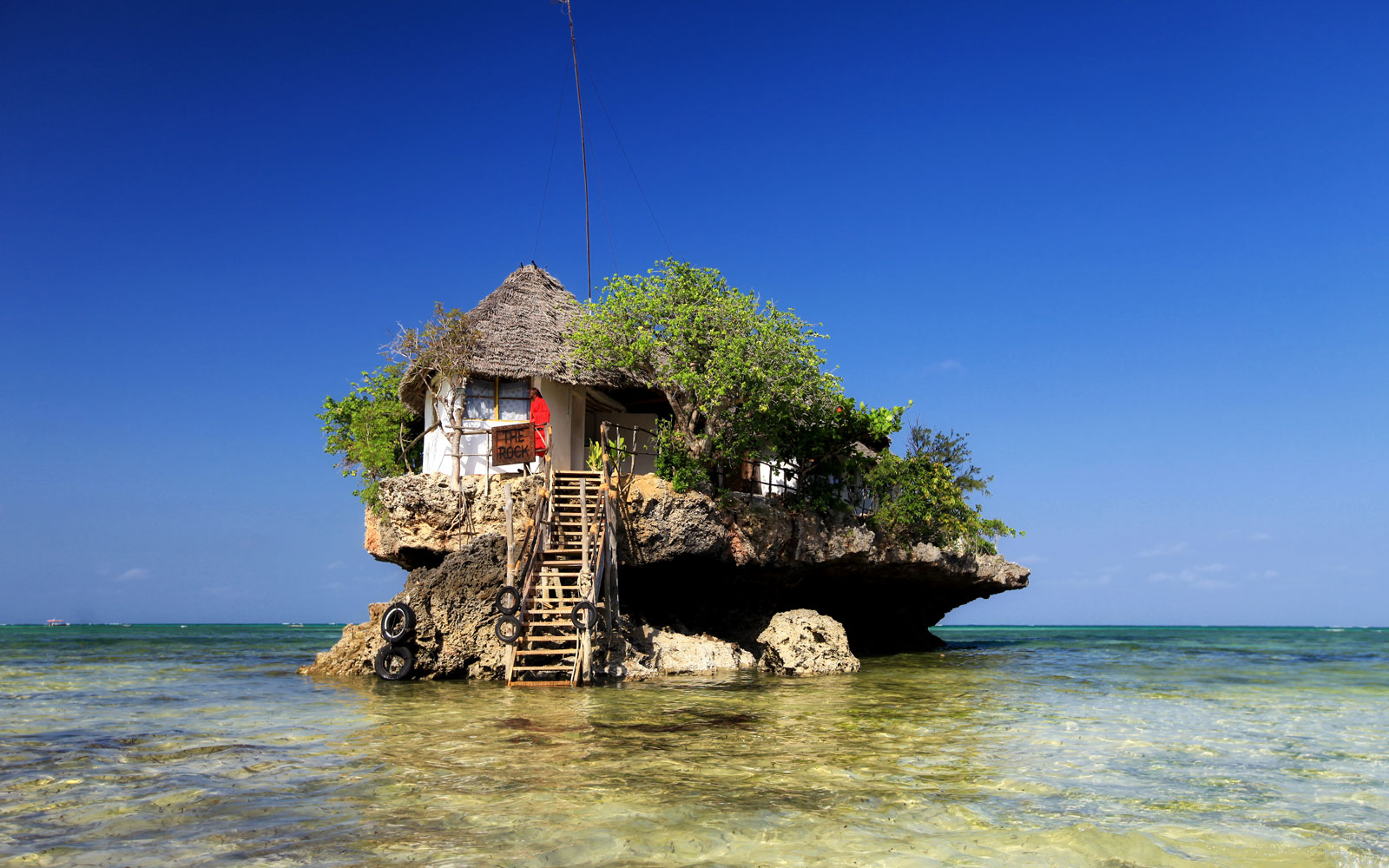 Chill Out at the World's Coolest Swim-Up Bars: Rock Restaurant in Stone Town, Zanzibar