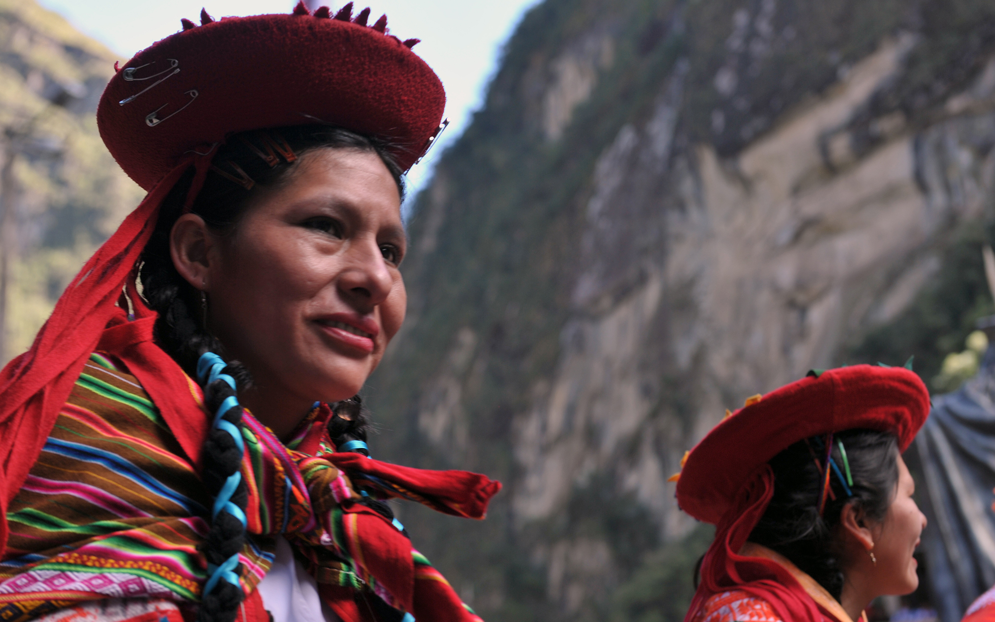 Women in traditional regional Andean attire participate in a civic parade on July 6, 2011 in the town of Machu Picchu at the mountain base under the Inca citadel as part of the festivities commemorating the centennial of its discovery by American adventur