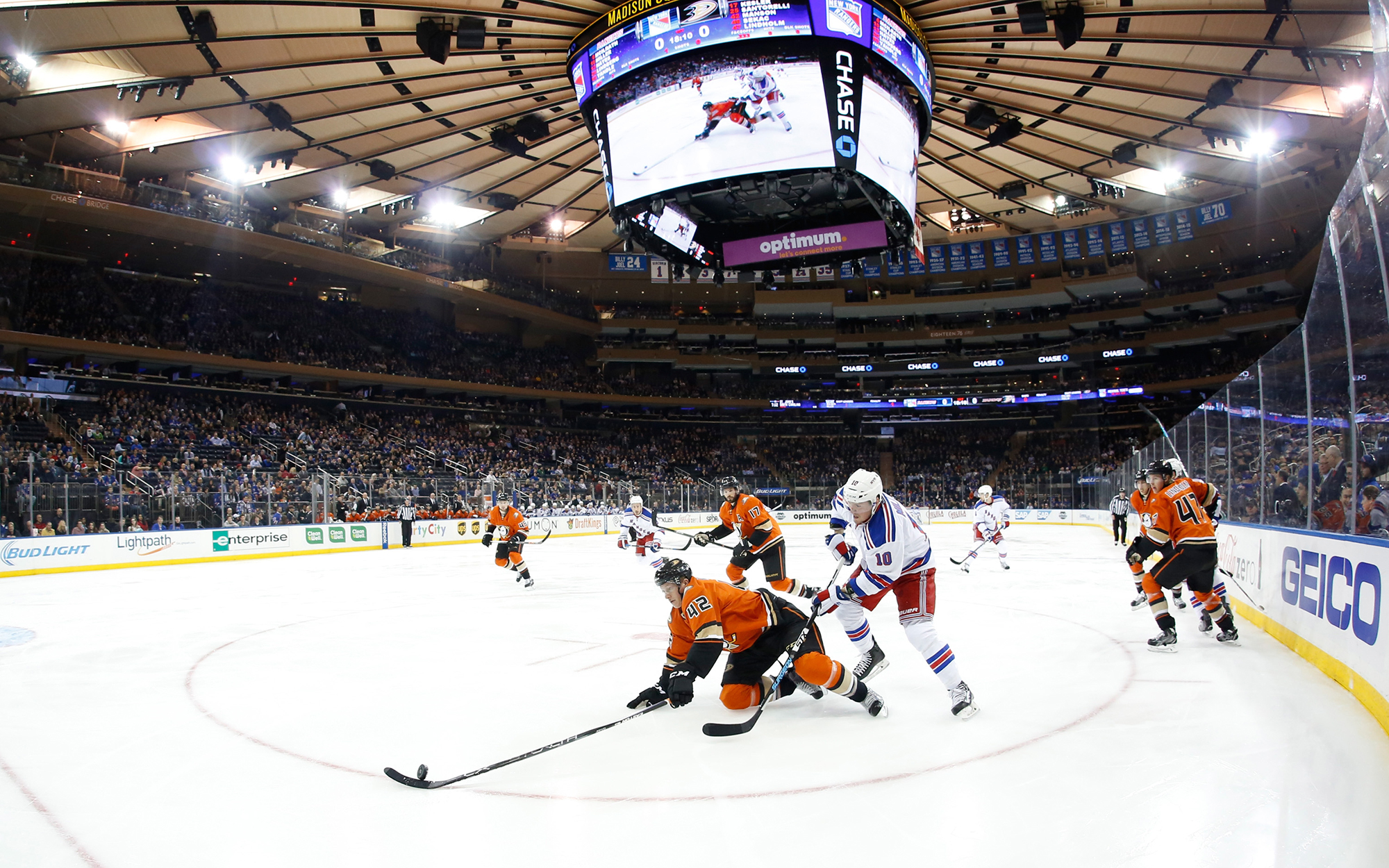 NEW YORK, NY - DECEMBER 22:  J.T. Miller #10 of the New York Rangers battles for the puck against Josh Manson #42 of the Anaheim Ducks at Madison Square Garden on December 22, 2015 in New York City. The New York Rangers won 3-2 in overtime. (Photo by Jare
