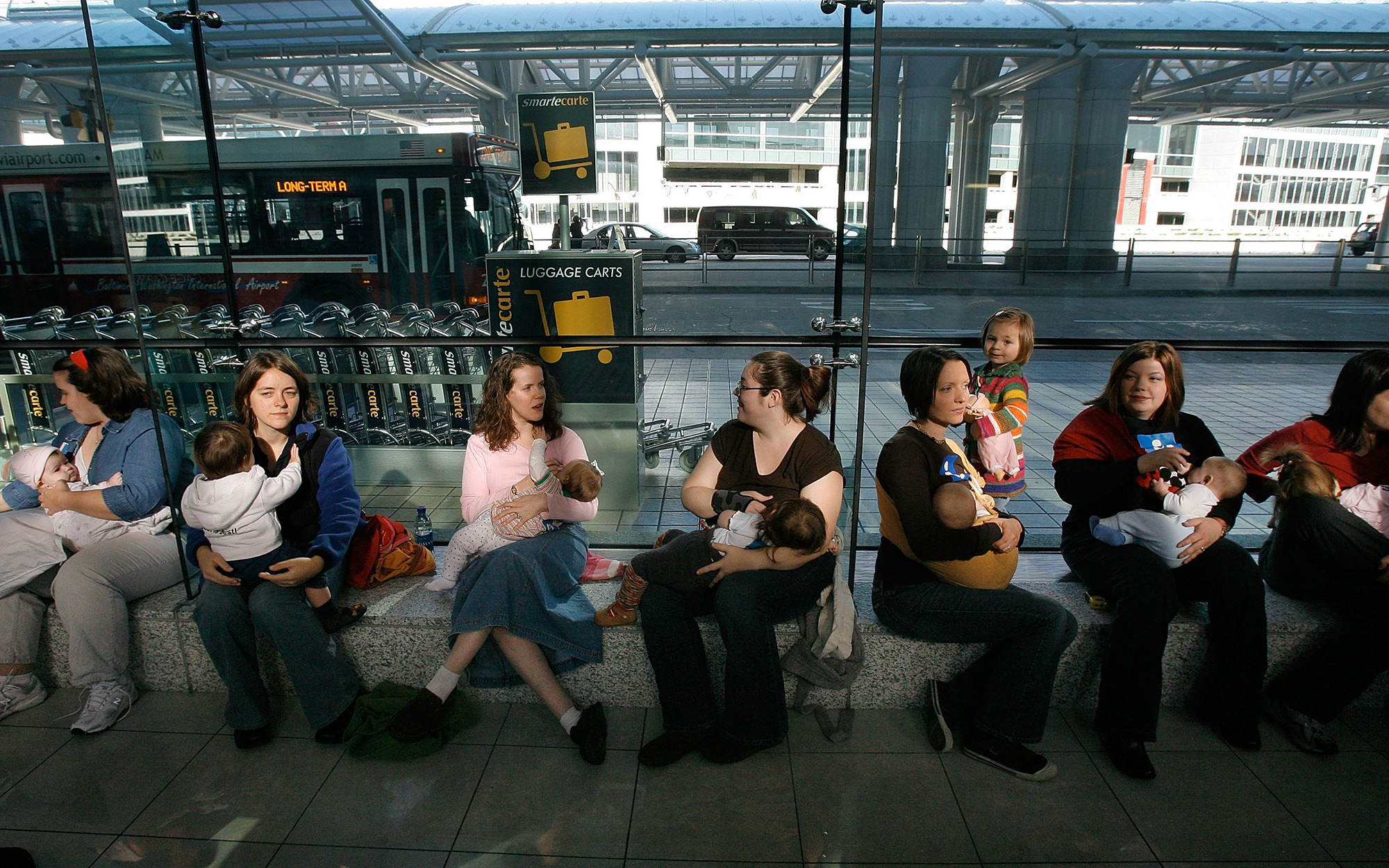 LINTHICUM, MD - NOVEMBER 21:   Mothers nurse their babies during a Nurse In protest at Baltimore-Washington International Thurgood Marshall Airport November 21, 2006 in Linthicum, Maryland. The mothers were protesting as a result of a prior incident in wh