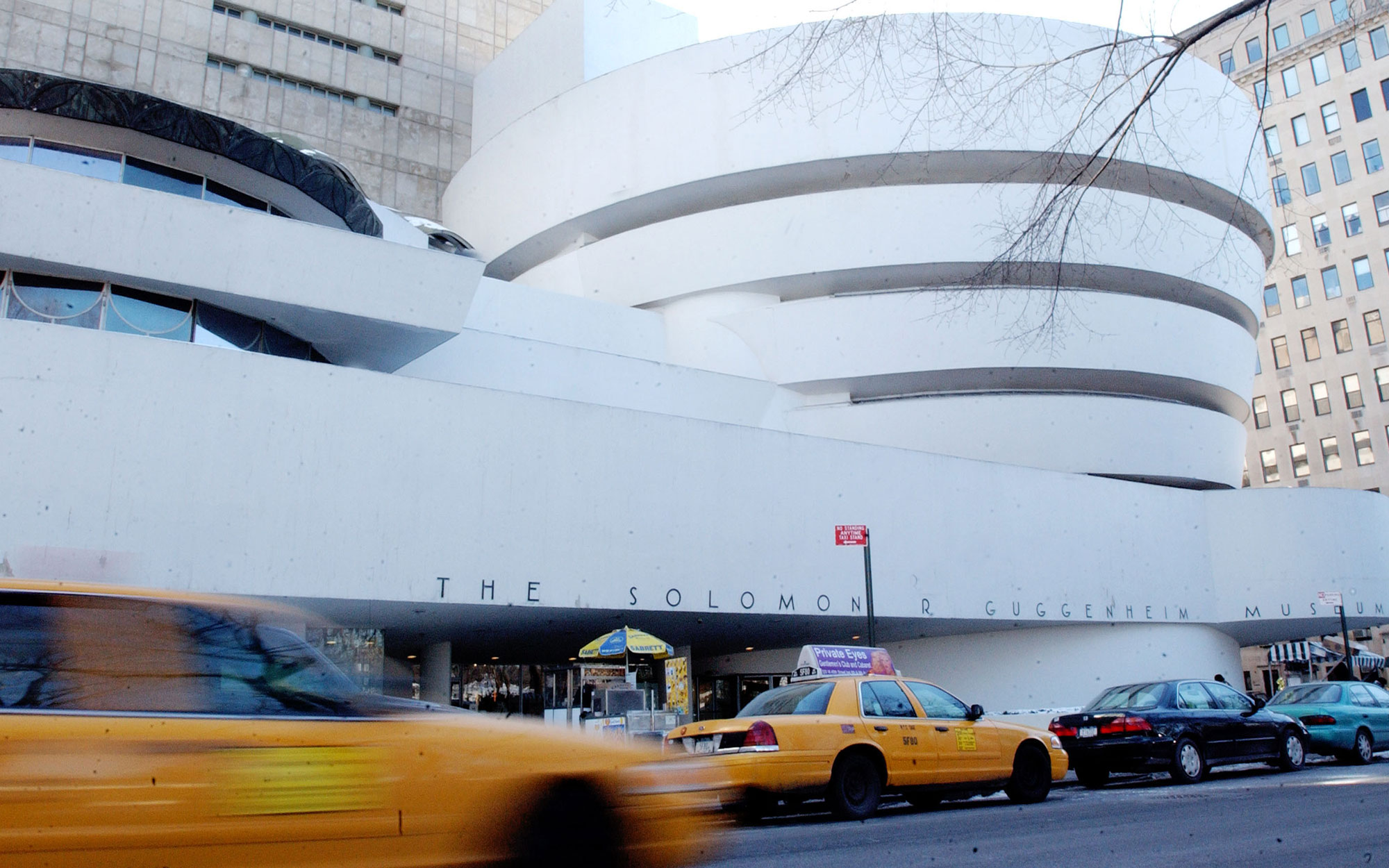 NEW YORK - JANUARY 21:  Traffic moves past the front of the Solomon R. Guggenheim Museum January 21, 2004 in New York City. Designed by architect Frank Lloyd Wright, the Guggenheim Museum was completed in 1959.  (Photo by Stephen Chernin/Getty Images)