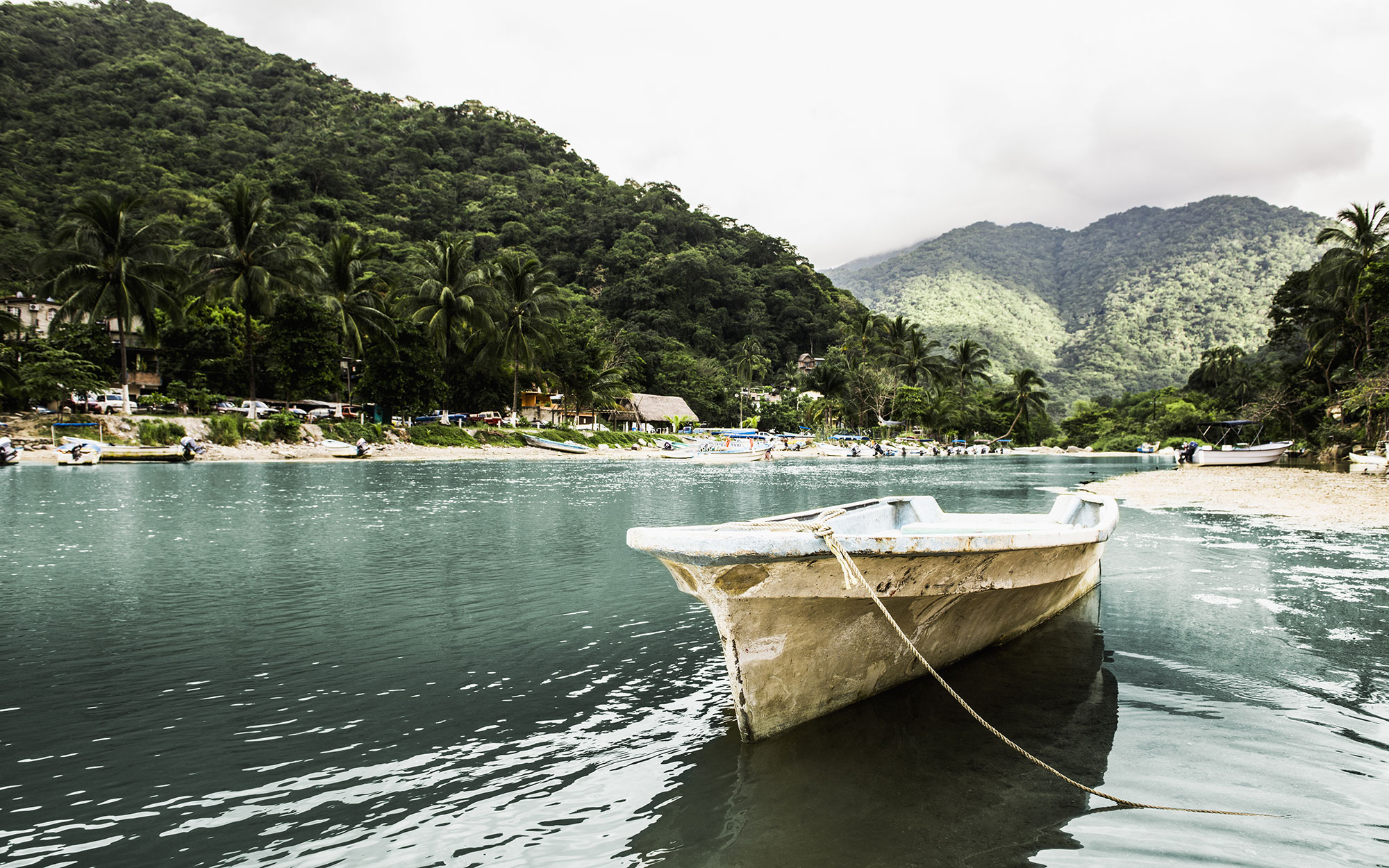 Docked boat floating in tropical bay