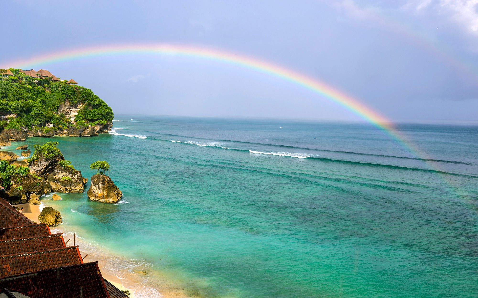 Rainbow over ocean,Bingin beach,Bali,Indonesia.