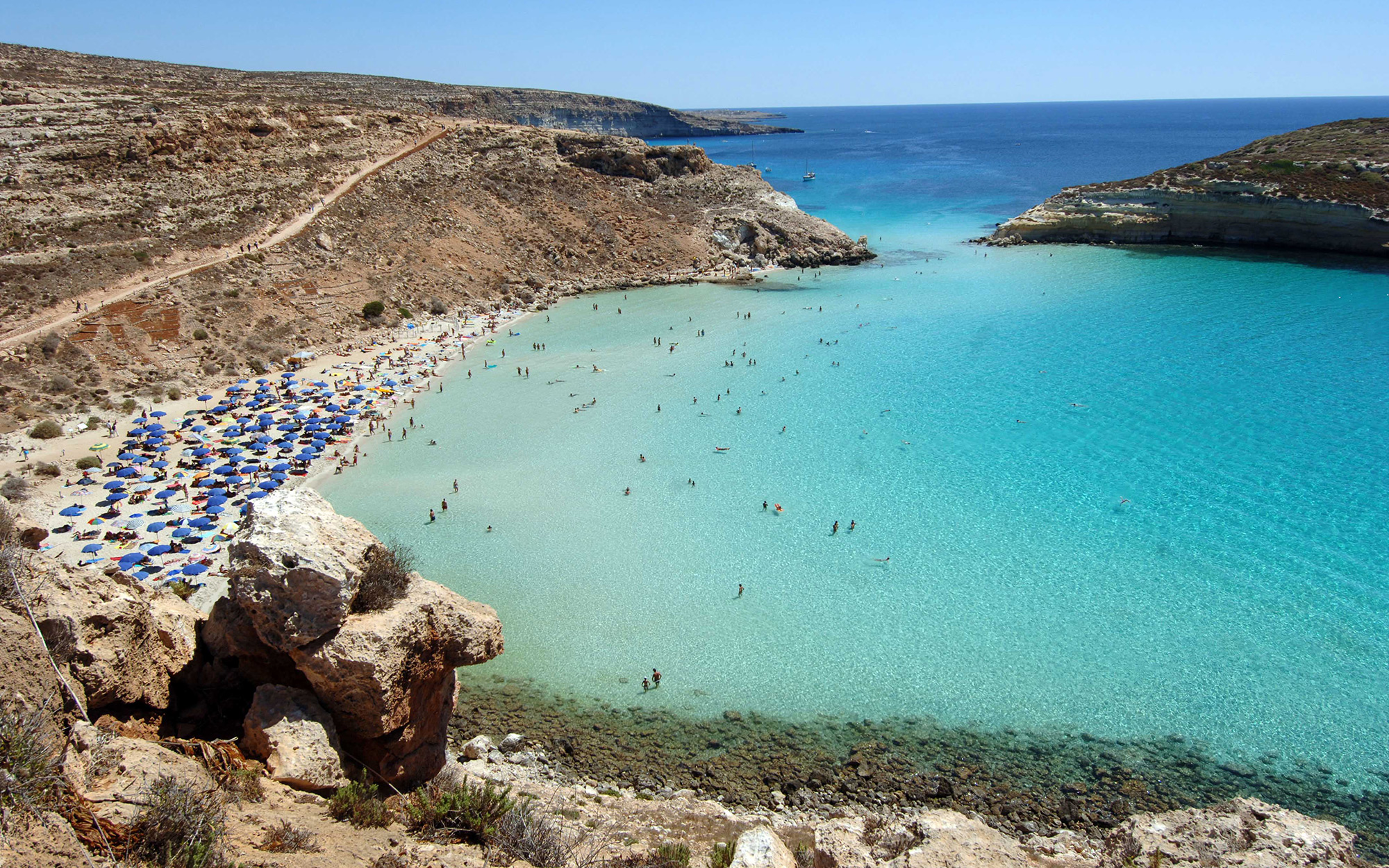 "ITALY - SEPTEMBER 04:  The ""Spiaggia dei Conigli"" or Rabbit Beach in Lampedusa, Italy, Monday, September 4, 2006. With its sun-kissed beaches and crystal-clear sea, Lampedusa could be a playground for the rich and famous. Instead, the 20-square-kilometer"