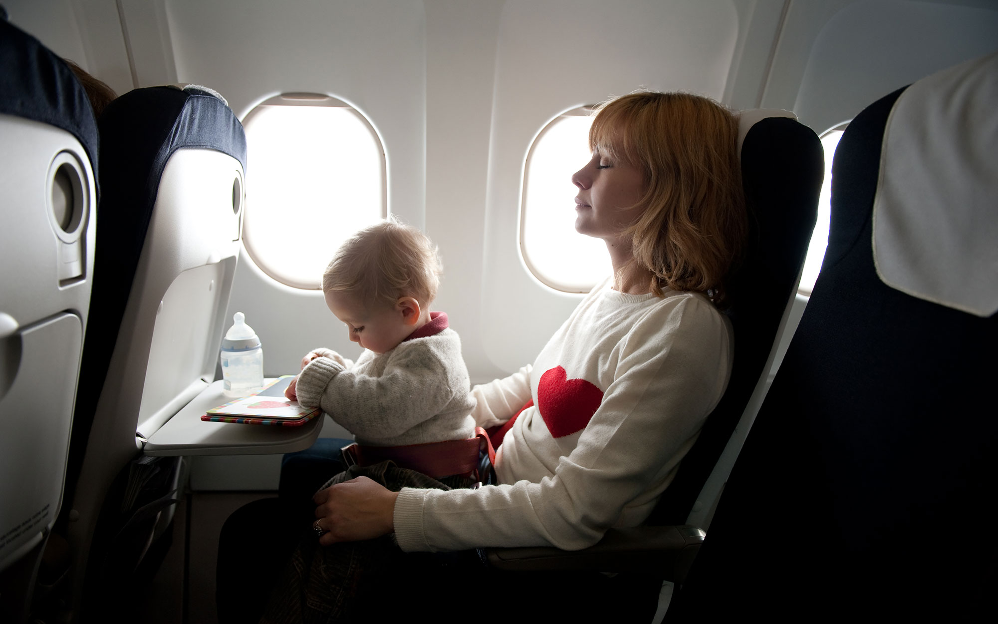 mother and baby on plane