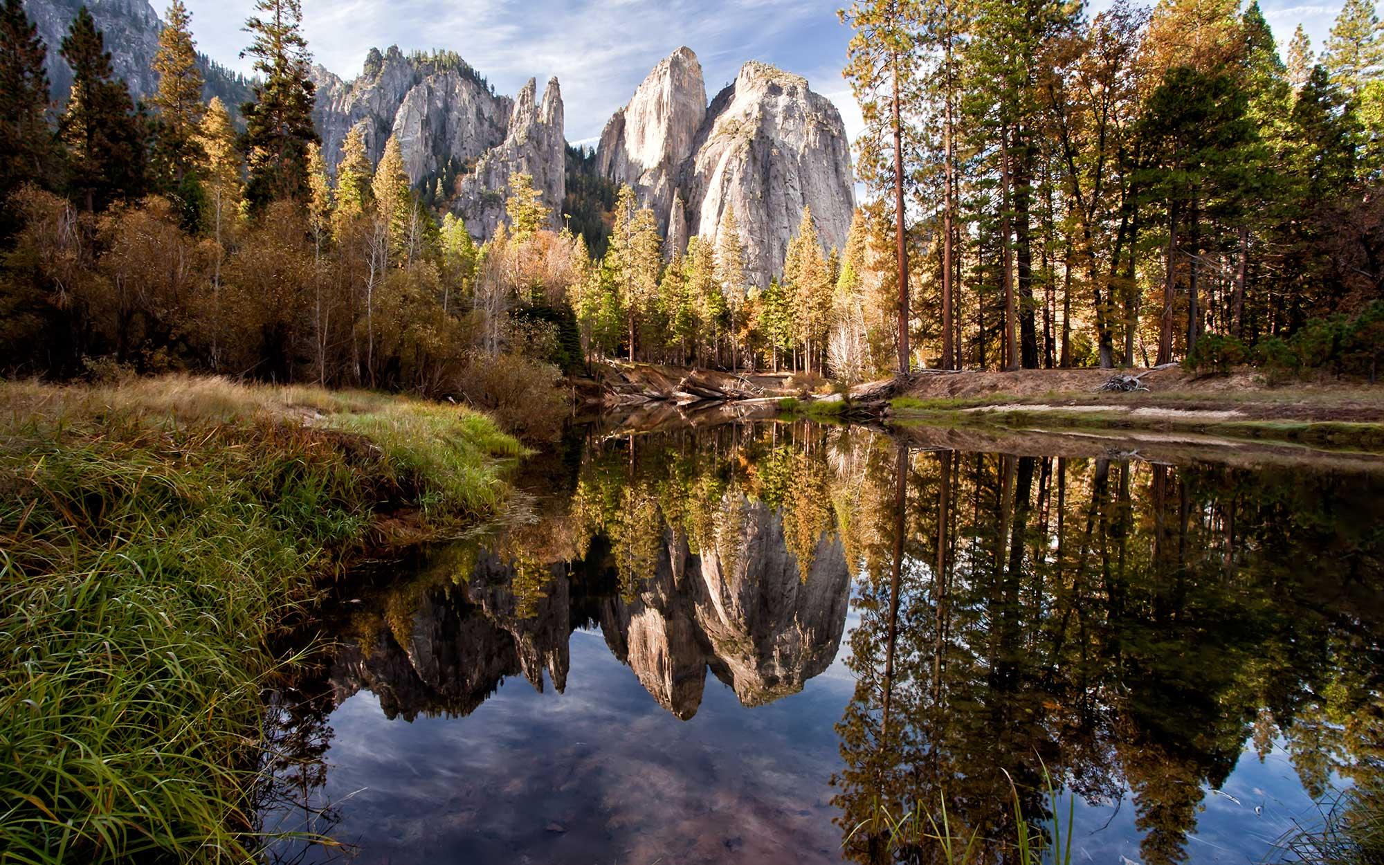 Beautiful cathedral rocks reflected in Merced river in Yosemite National Park.