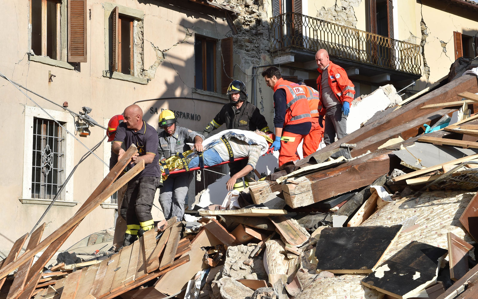 Teams rescue people who were trapped in the buildings that crumbled in the earthquake on Aug. 24, 2016.
