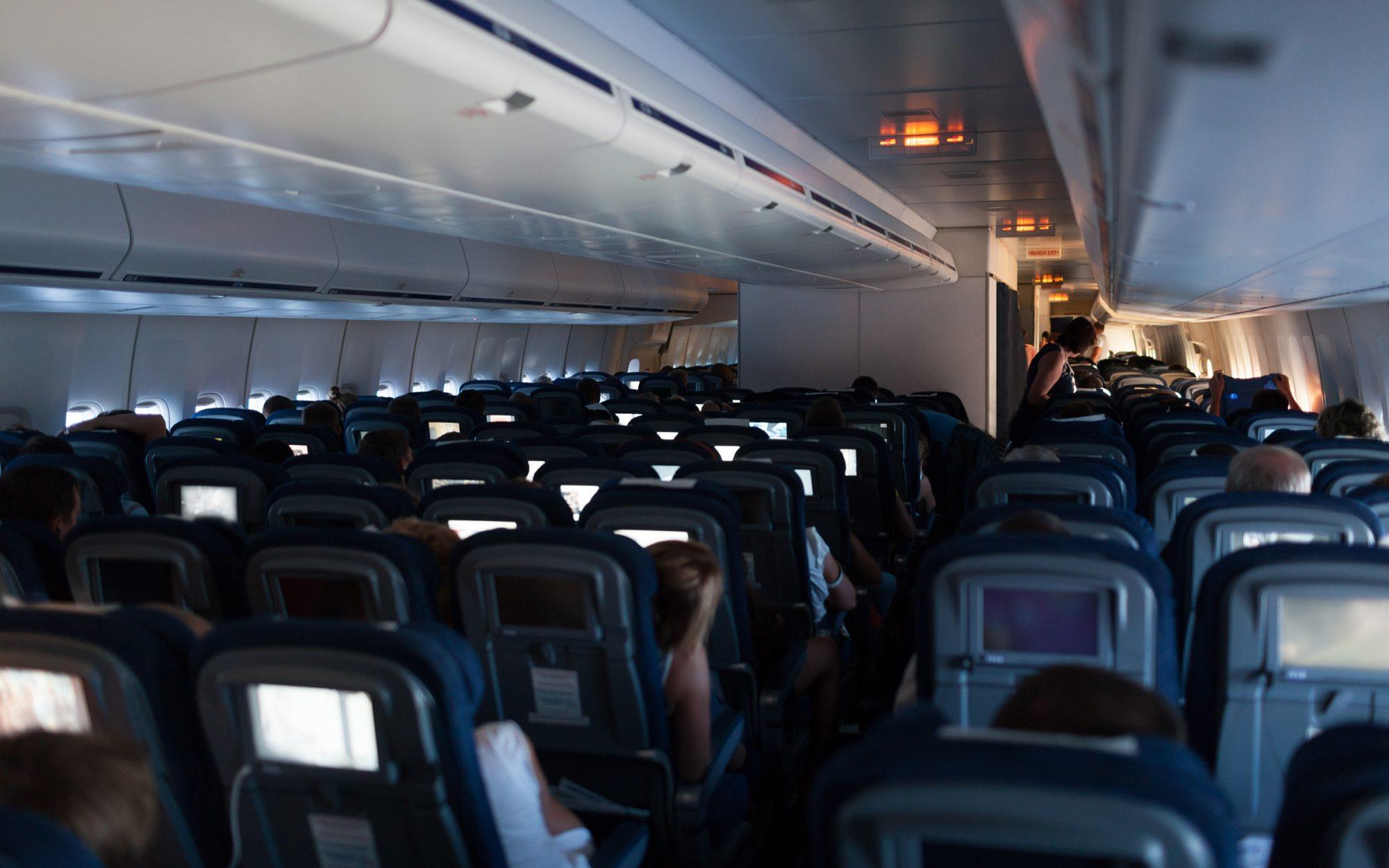 Airplane cabin with dim lights