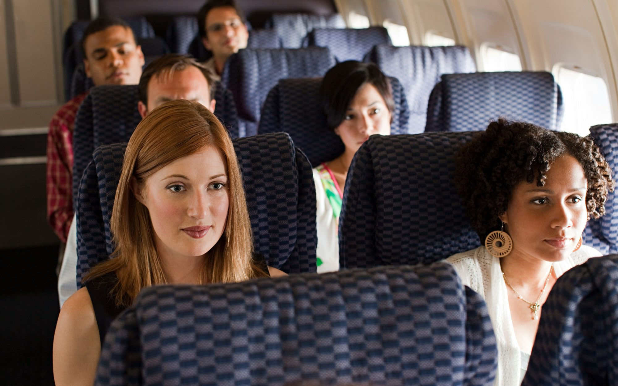 Airplane passengers seated