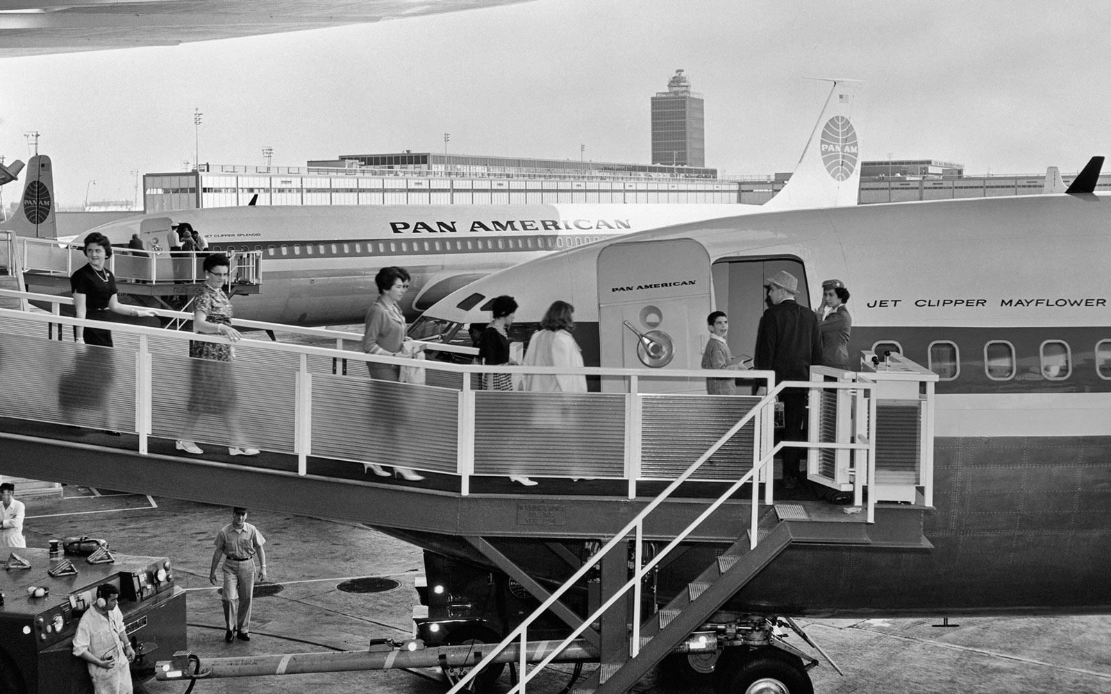 Passengers board a plane in the 1950s.