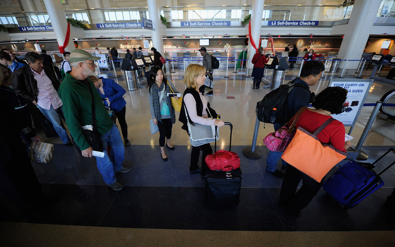 Paging Ferris Bueller: American Airlines new boarding process has *nine* different groups.