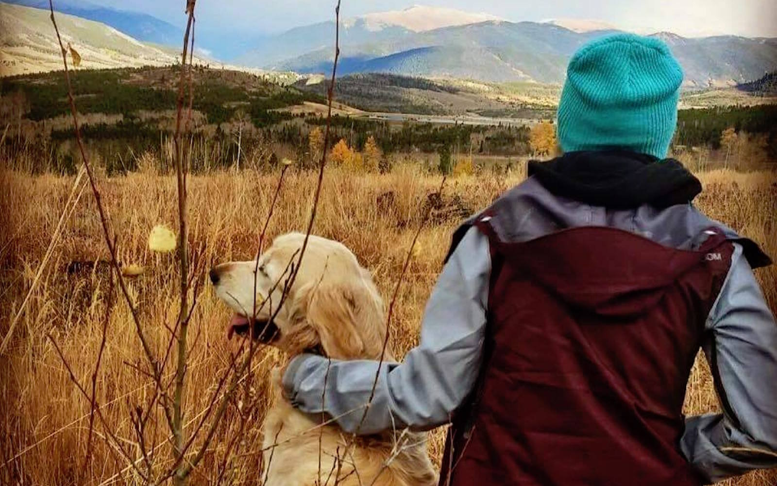 Kathleen Considine takes in a nature scene with her golden retriever, Jacob