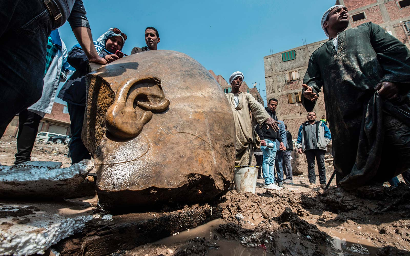 Ancient Statue Believed to be of Pharaoh Ramses II Discovered in Cairo Slum