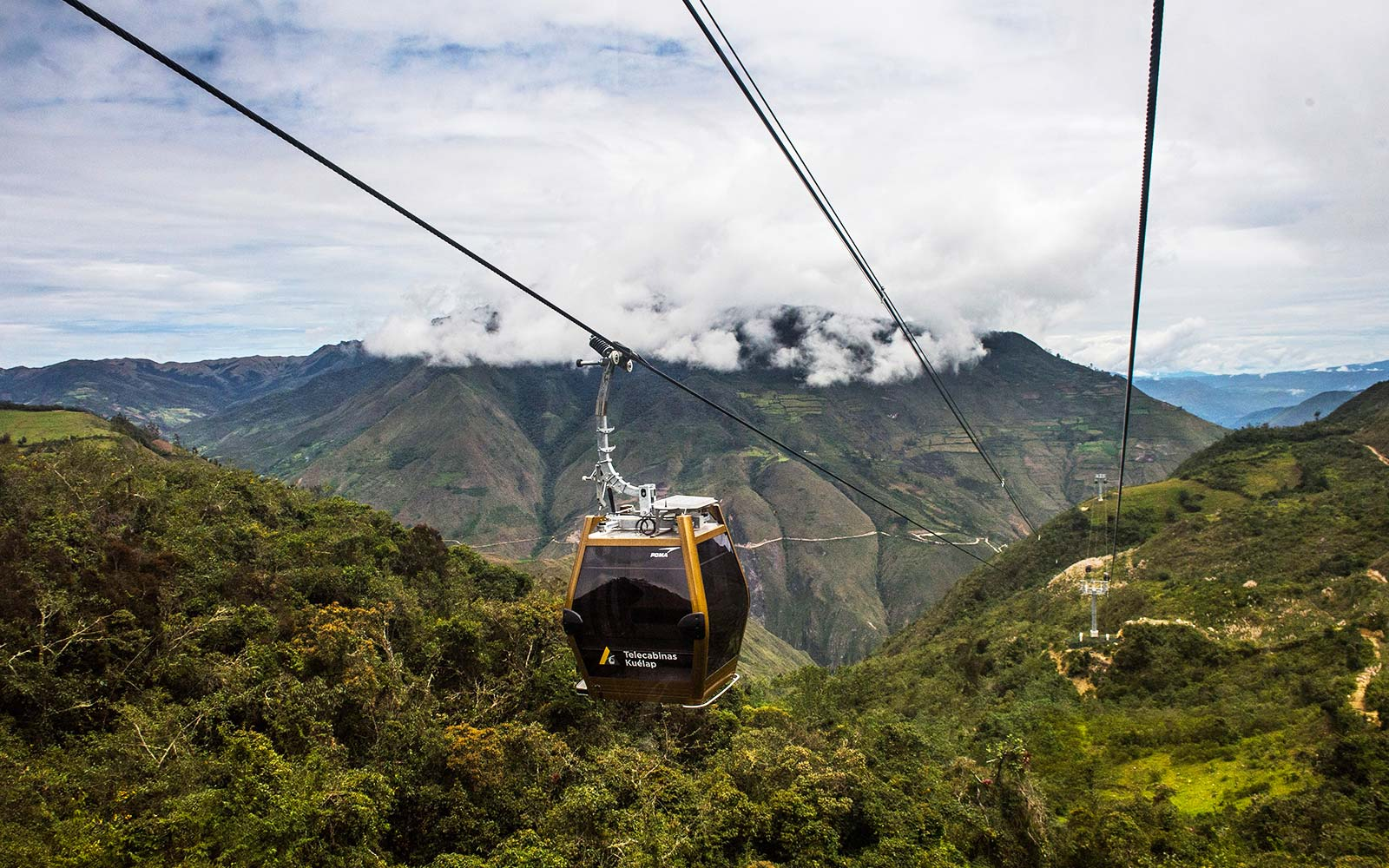 Tourists use a new cable car system to reach Kuelap Peru