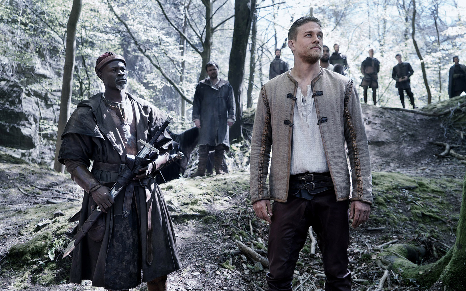 """""""King Arthur: Legend of the Sword"""" stars Charlie Hunnam, Jude Law, Astrid Berges-Frisbey, and Djimon Hounsou."""