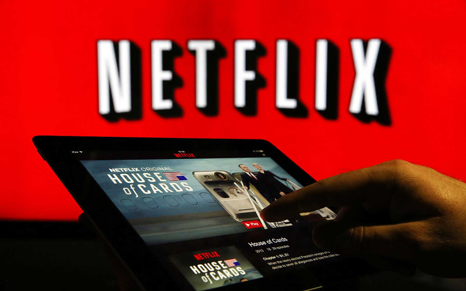 A man prepares to watch House Of Cards on the Netflix Inc. application on a tablet device in this arranged photograph in London, U.K., on Tuesday, Jan. 5, 2016. Netflix Inc., which delivered the best return of any stock in the S&P 500 last year, has ambit