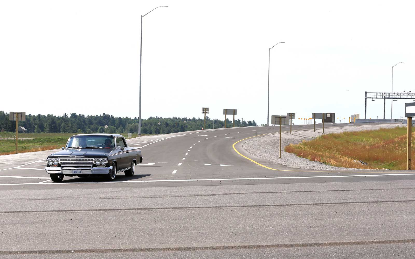 A vintage car comes off the ram at Lake Ridge off the 412 to Highway 7 east.