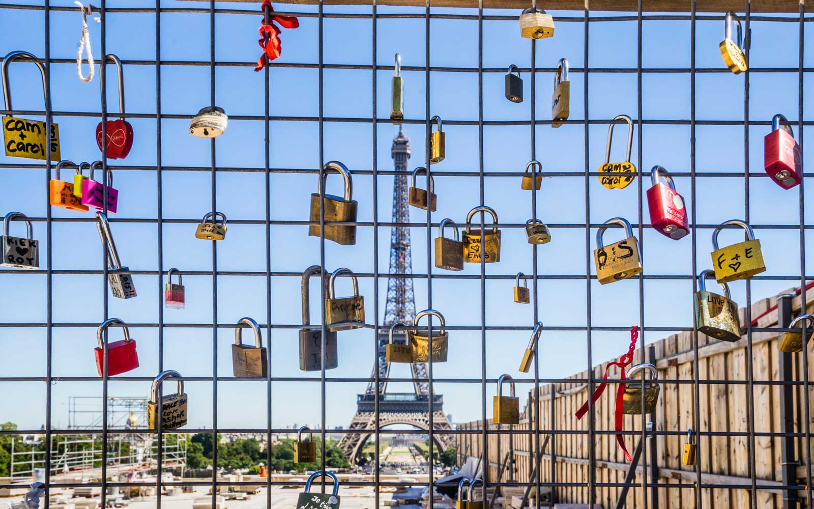 France, Paris, love locks on a construction fence at the Esplanade du Trocadéro, against the backdrop of the Eiffel Tower