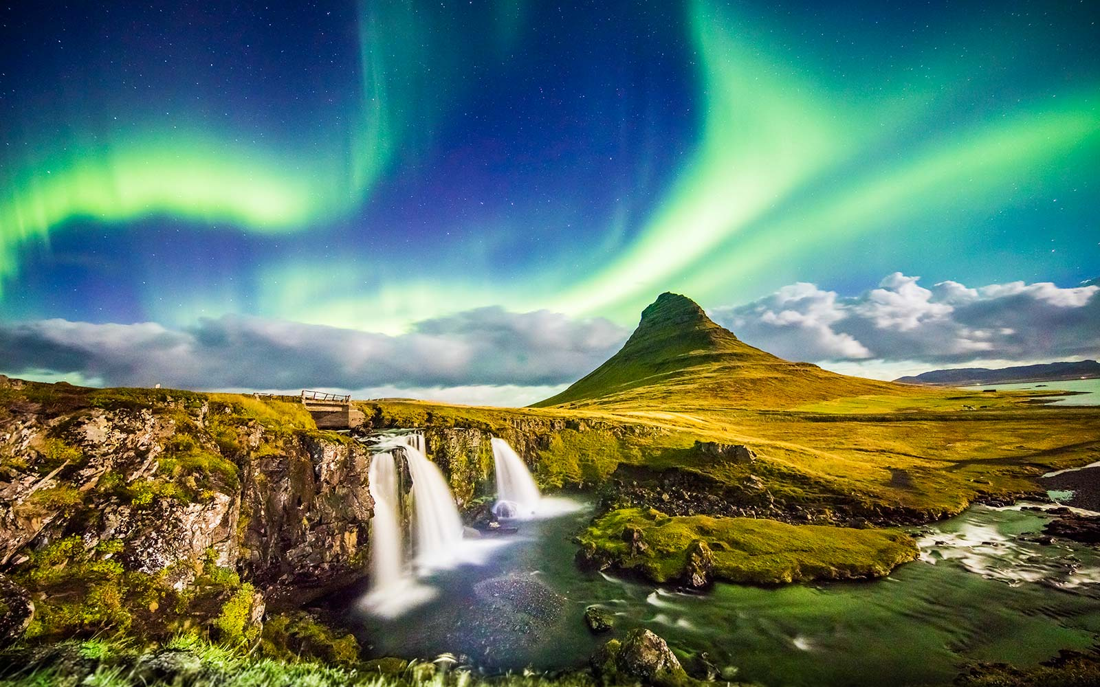 aurora over Kirkjufell and waterfall Northern Lights Iceland