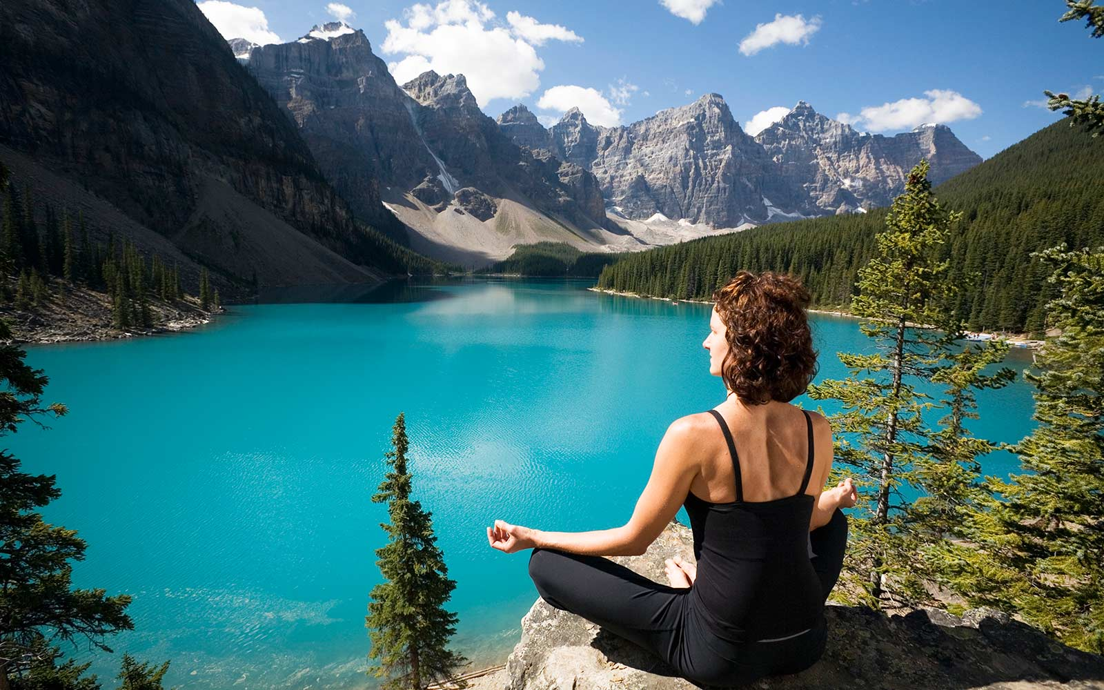 Moraine Lake is a glacially fed lake in Banff National Park, Village of Lake Louise, Alberta, Canada yoga