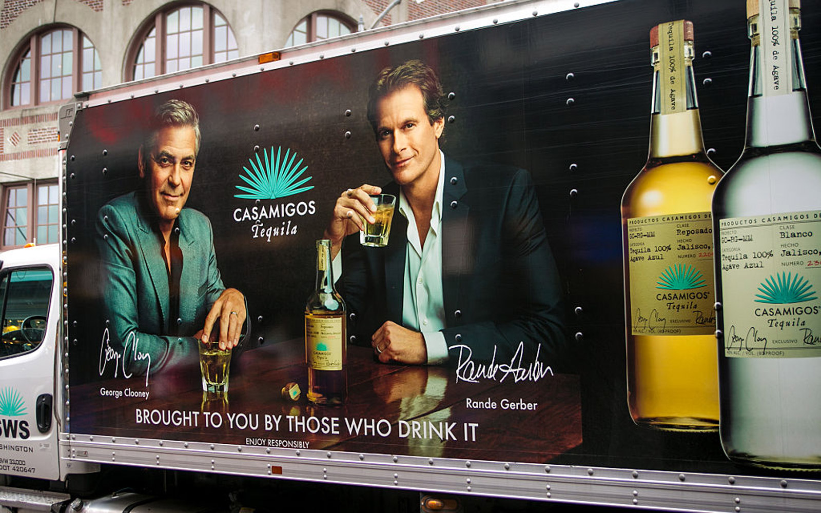 SEATTLE, WA - NOVEMBER 5: The side of a delivery truck features a billboard promoting George Clooney and Rande Gerber's new Casamigos Tequila on November 5, 2015, in Seattle, Washington. Seattle, located in King County, is the largest city in the Pacific