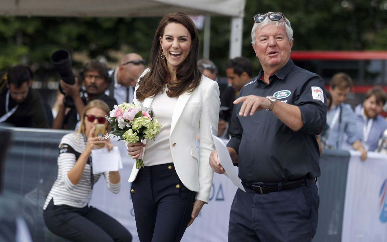 Britain's Catherine, Duchess of Cambridge (C), Patron of the 1851 Trust, is welcomed by Keith Mills as she attends the charity's final Land Rover BAR Roadshow at the Docklands Sailing and Watersports Centre in London, June 16, 2017. 