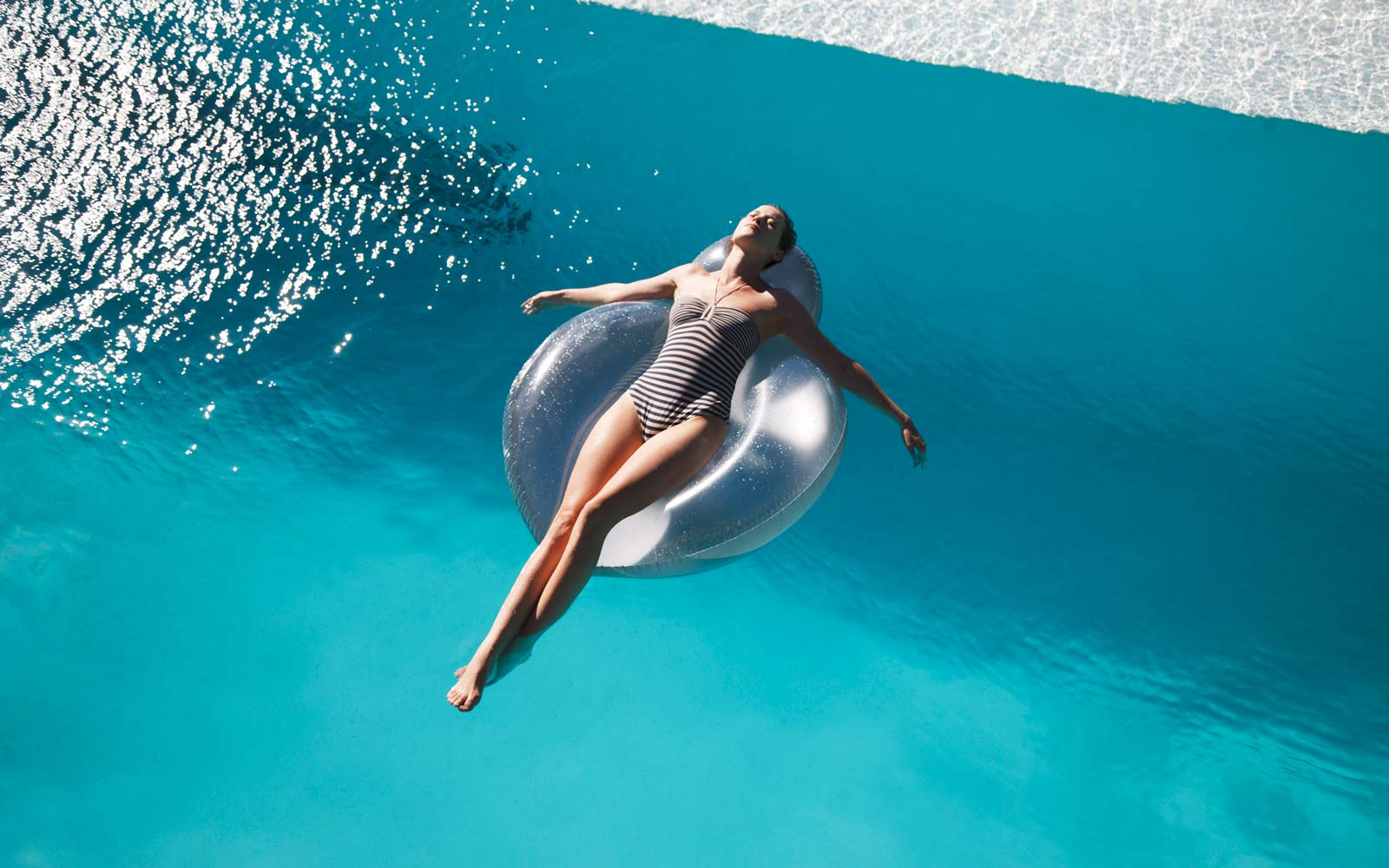 Woman lounging in a pool