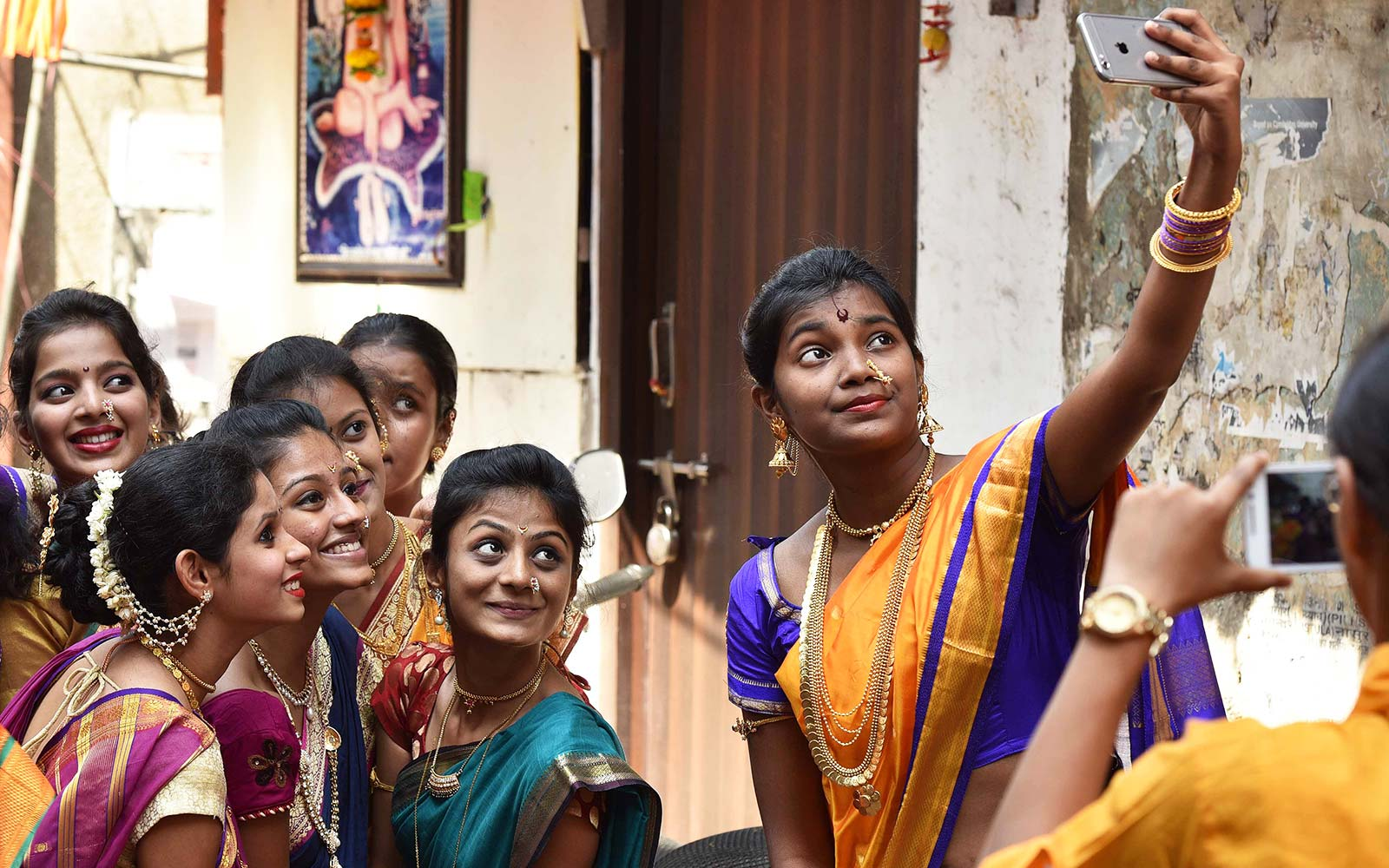 Girls take selfie during Gudi Padwa procession in Mumbai, India