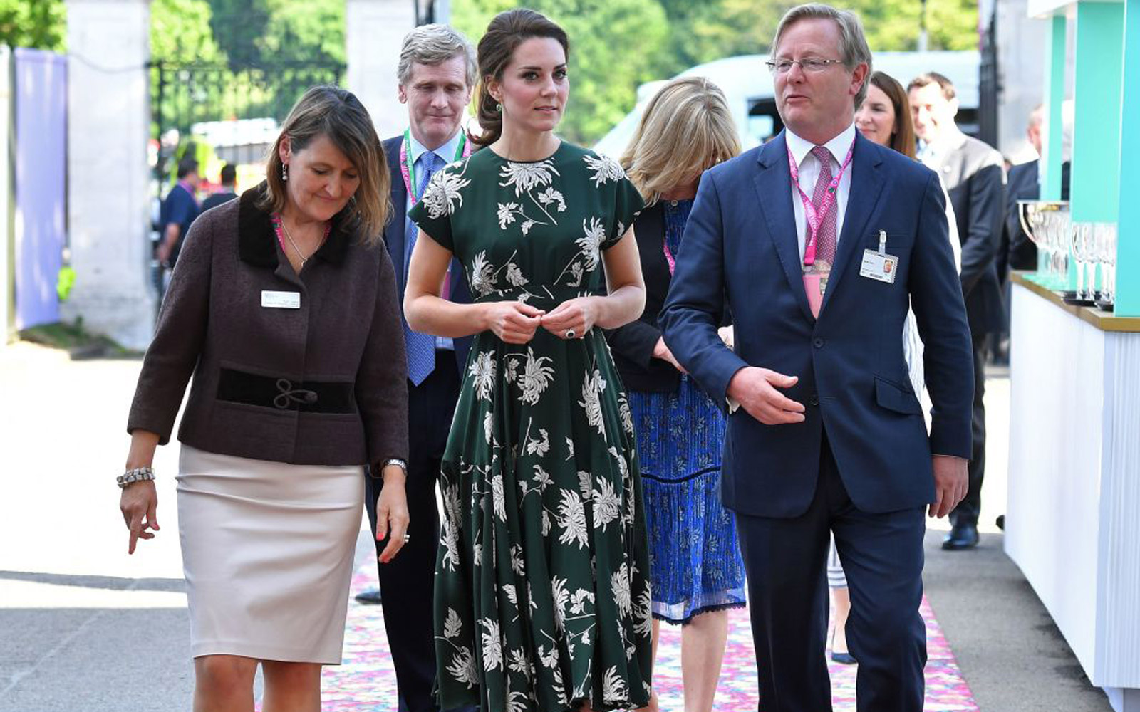 Britain's Catherine, Duchess of Cambridge (C), talks with Royal Horticultural Society (RHS) judge Mark Fane (R) as she arrives at the Chelsea Flower Show in London on May 22, 2017.The Chelsea flower show, held annually in the grounds of the Royal Hospita