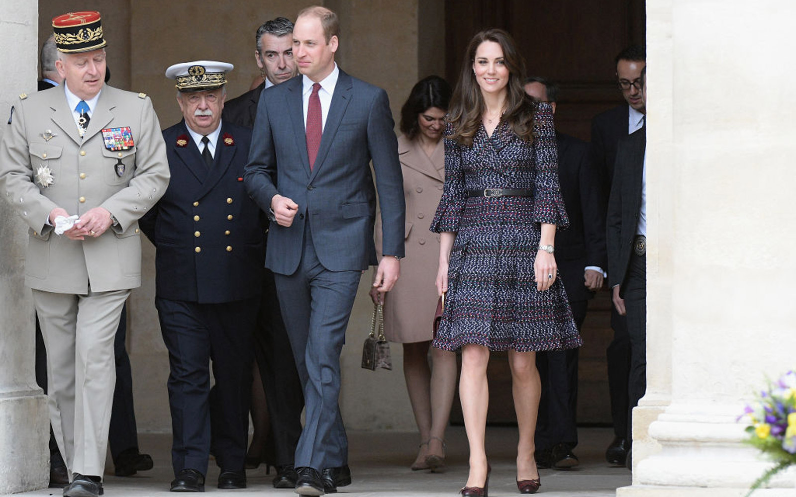 PARIS, FRANCE - MARCH 18:  General Bertrand Ract Madoux (L), Governor of Invalides,  Prince William, Duke of Cambridge (C)  Catherine, Duchess of Cambridge (R) Leave after a visit at the hotel des invalide on March 18, 2017 in Paris, France. The Duke and