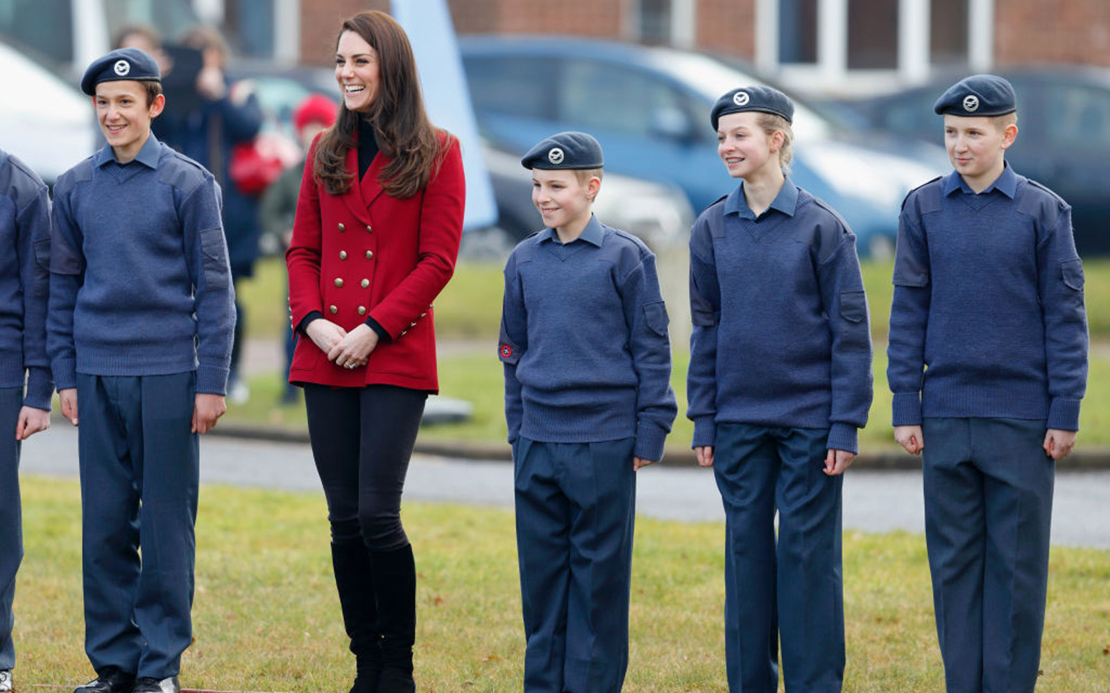 STAMFORD, UNITED KINGDOM - FEBRUARY 14: (EMBARGOED FOR PUBLICATION IN UK NEWSPAPERS UNTIL 48 HOURS AFTER CREATE DATE AND TIME) Catherine, Duchess of Cambridge joins in with a team building exercise during a visit to RAF Wittering to meet air cadets taking