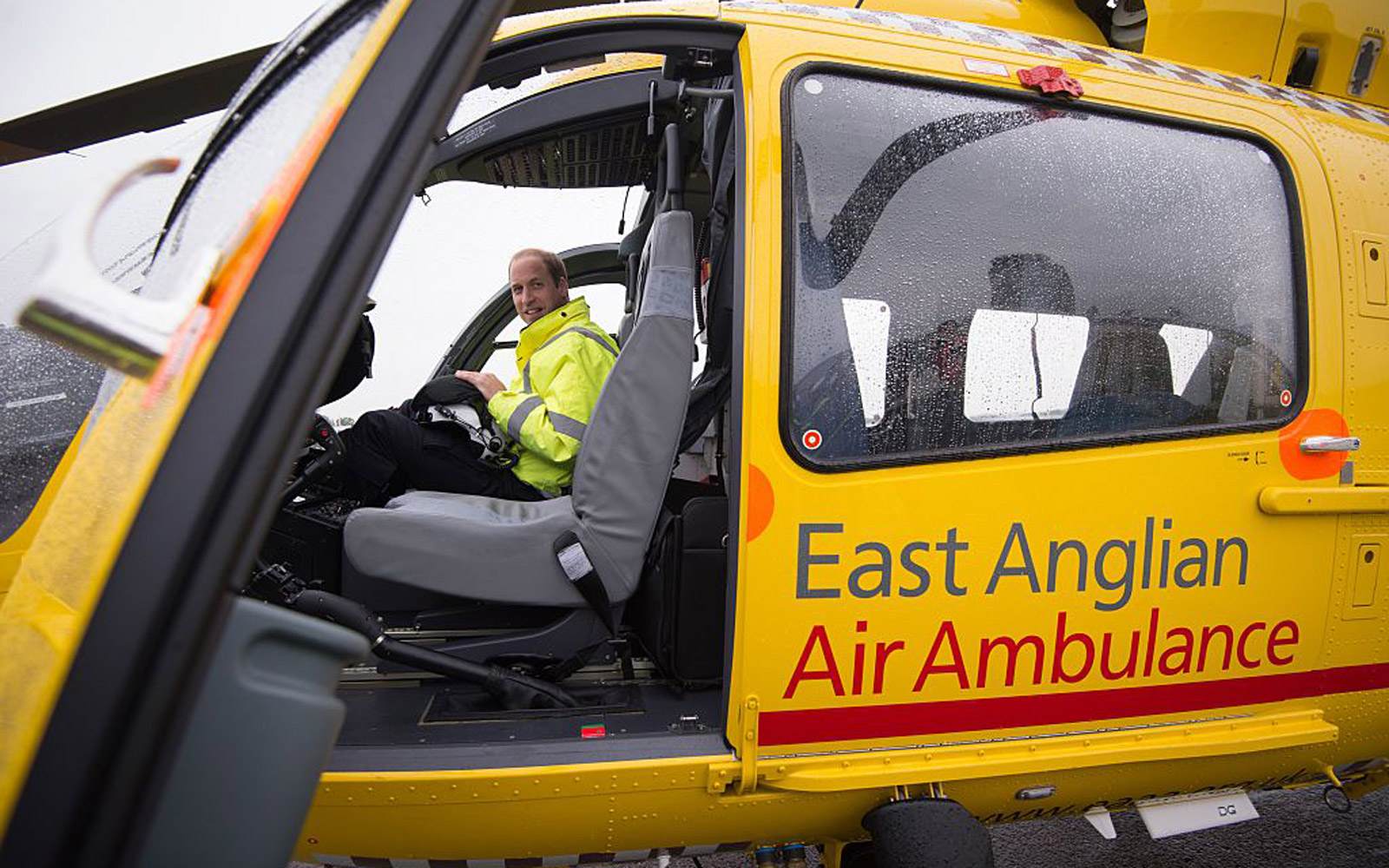 Britain's Prince William, The Duke of Cambridge poses in the cockpit of a helicopter air ambulance he begins his new job with the East Anglian Air Ambulance (EAAA) at Cambridge Airport on July 13, 2015. The former RAF search and rescue helicopter pilot wi
