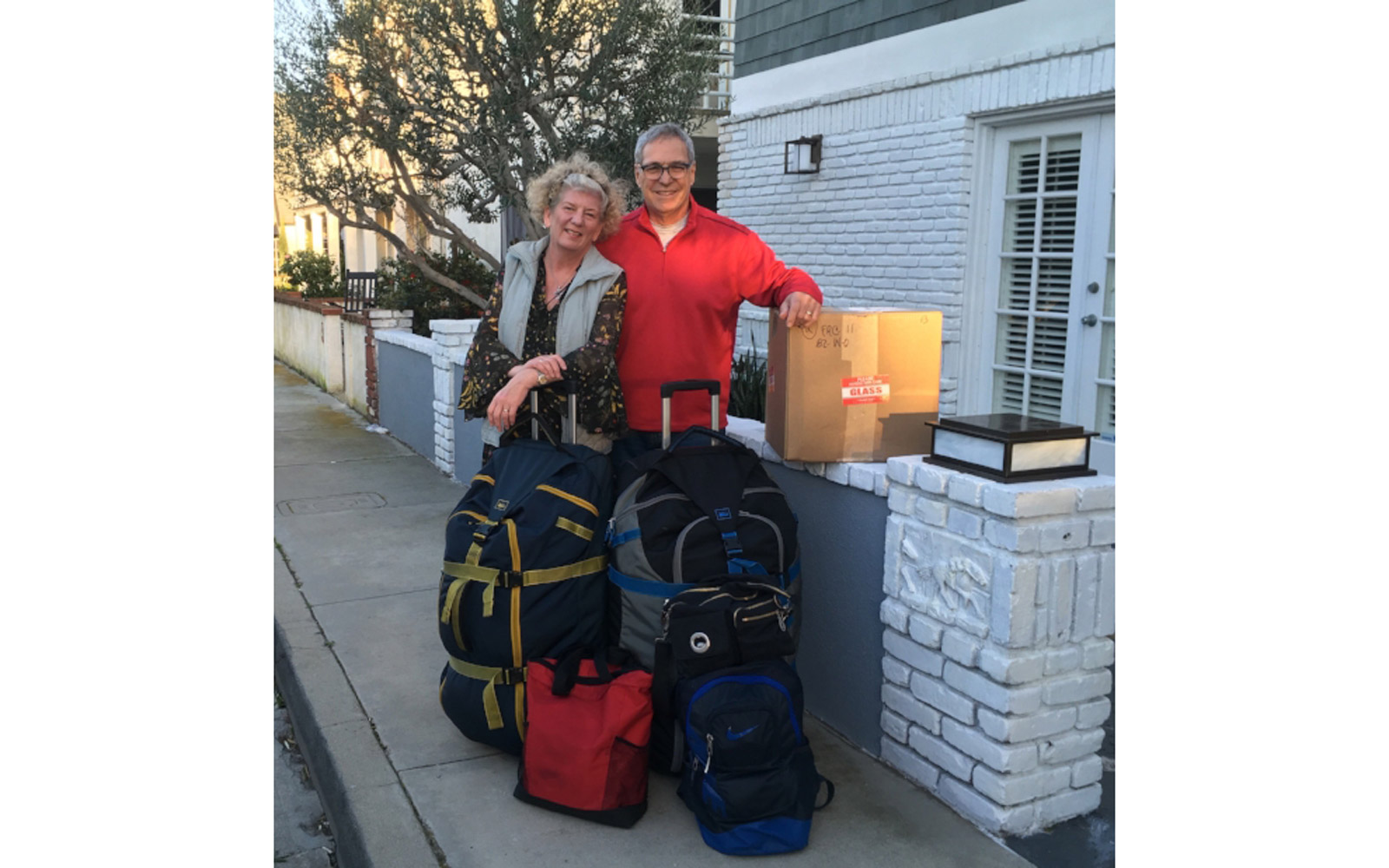 Michael and Debbie Campbell with luggage