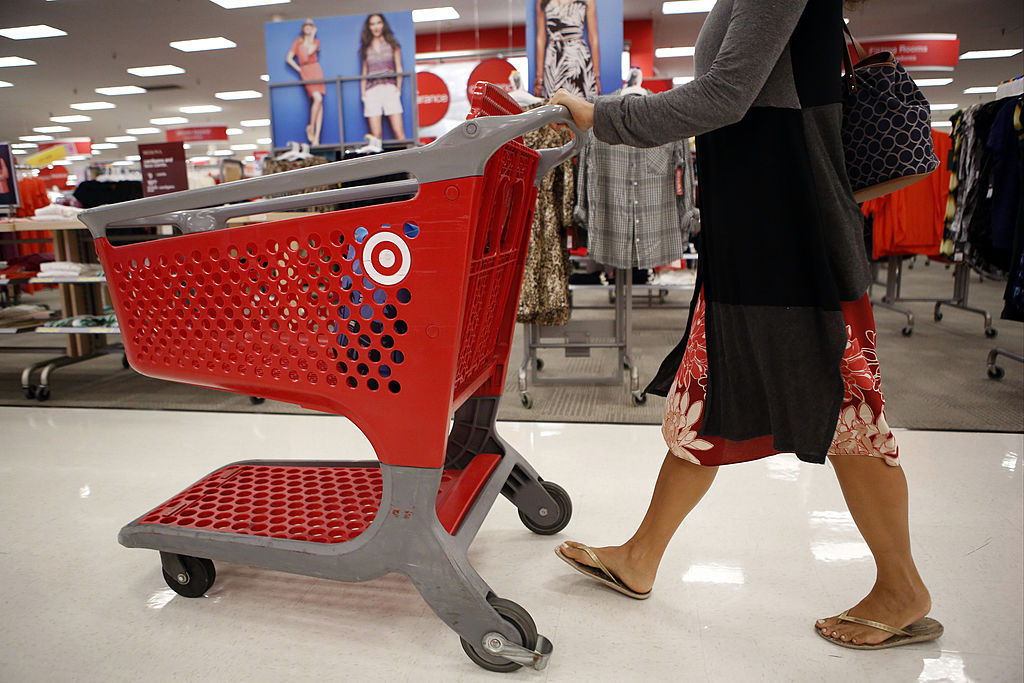 Shoppers walk though a Target Corp. store in Torrance, California, U.S., on Tuesday, August 20, 2013. Target is expected to announce quarterly earnings results on Aug. 21, 2013. Photographer: Patrick T. Fallon/Bloomberg via Getty Images