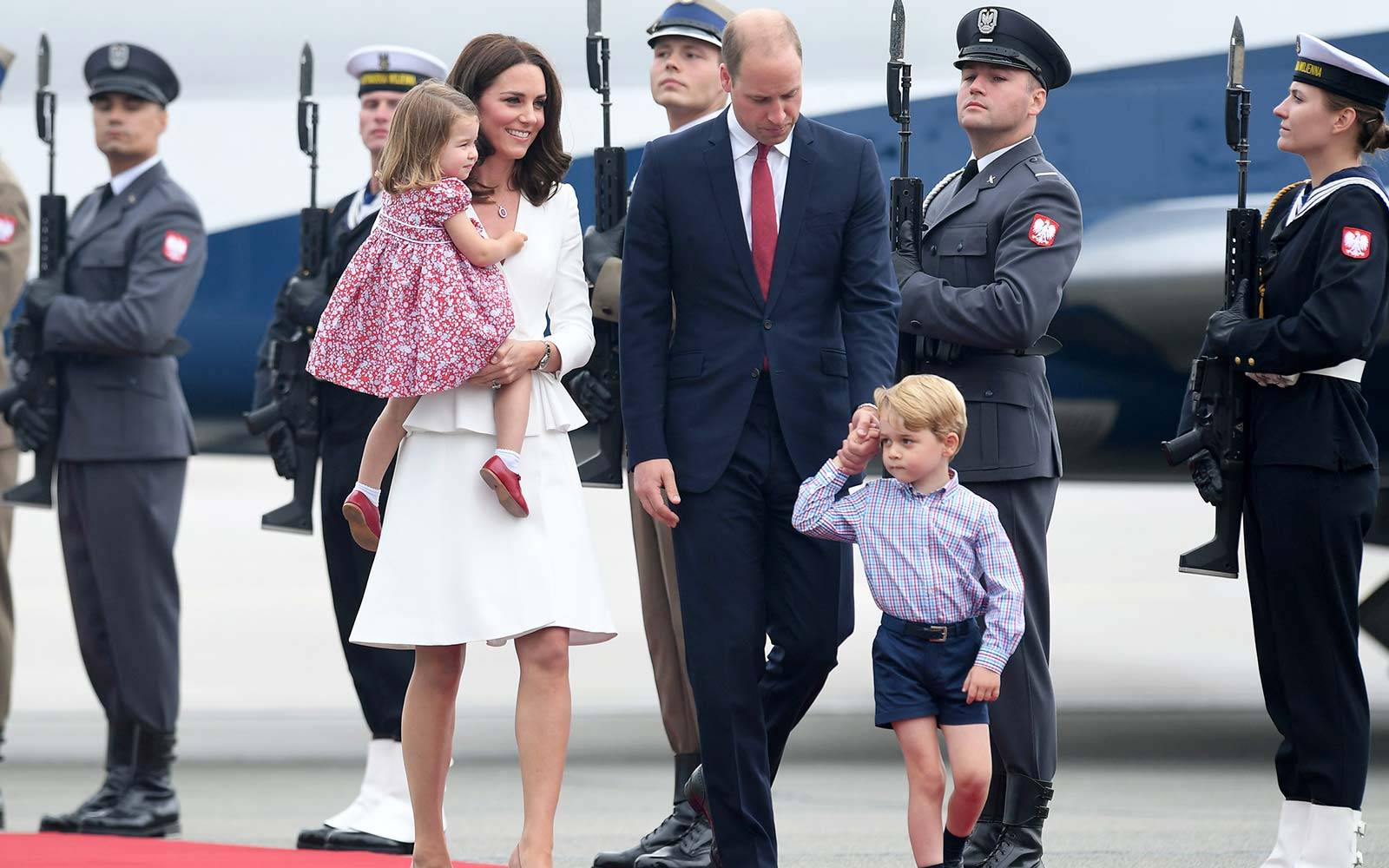Princess Charlotte, Catherine, Duchess of Cambridge, Prince George and Prince William, Duke of Cambridge arrive at Warsaw airport ahead of their Royal Tour of Poland and Germany