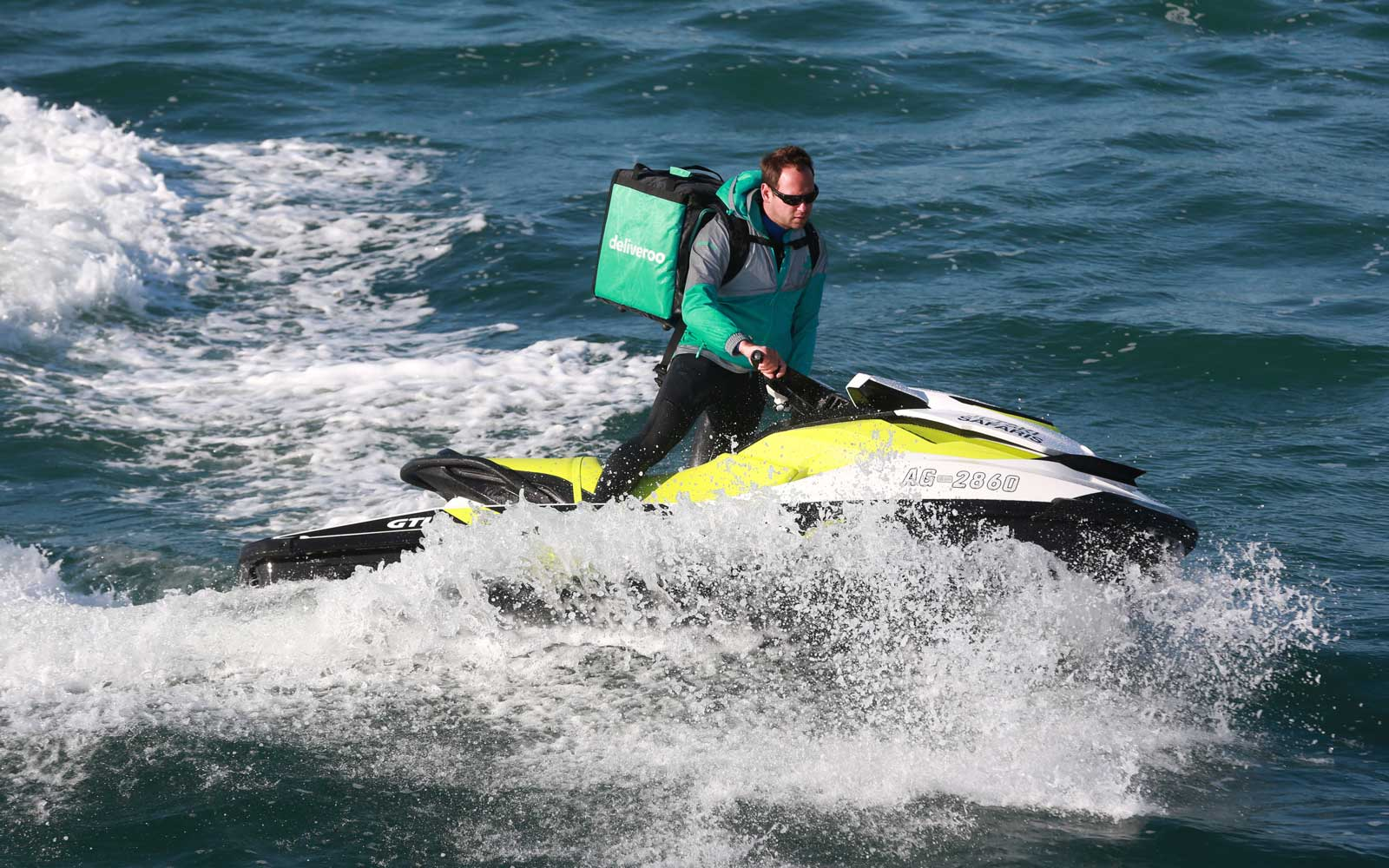 A takeaway meal via jet ski as on-demand food delivery service Deliveroo